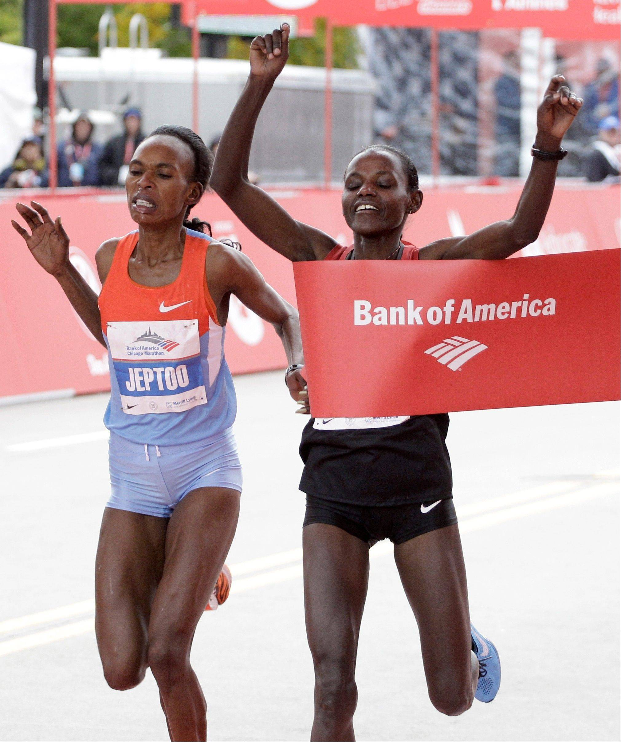 Atsede Baysa of Ethiopia right, edges out Kenya's Rita Jeptoo left, to win the 2012 Chicago Marathon Sunday, Oct. 7, 2012.