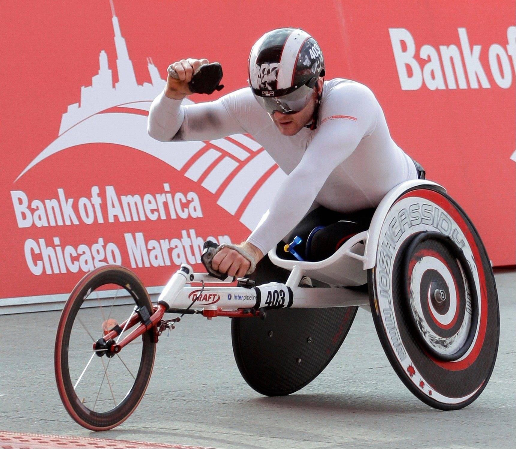 Josh Cassidy of Canada, crosses the finish line to win the wheelchair division of the 2012 Chicago Marathon Sunday, Oct. 7, 2012.