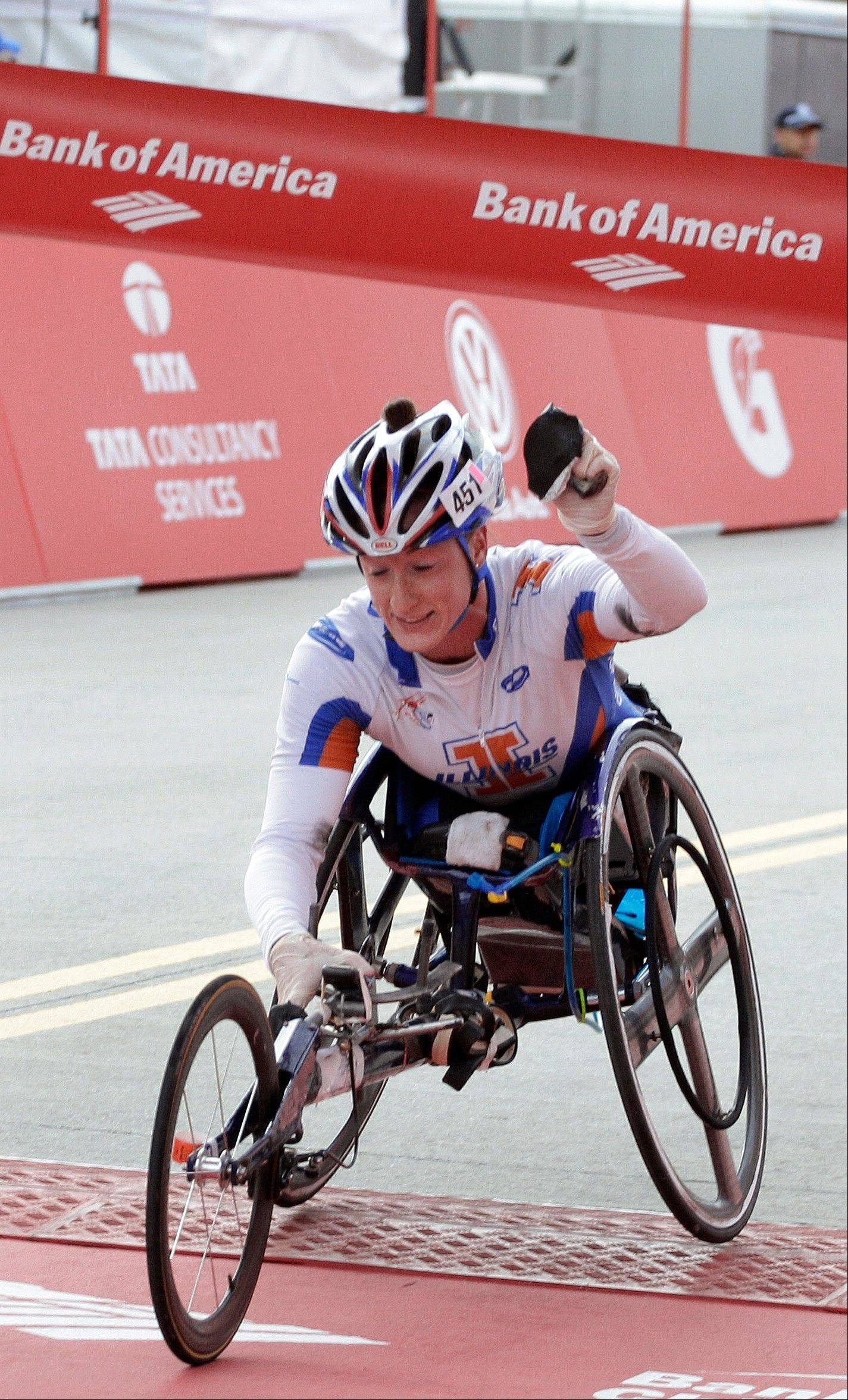 Tatyana McFadden crosses the finish line to win the women's wheelchair division of the 2012 Chicago Marathon Sunday, Oct. 7, 2012.