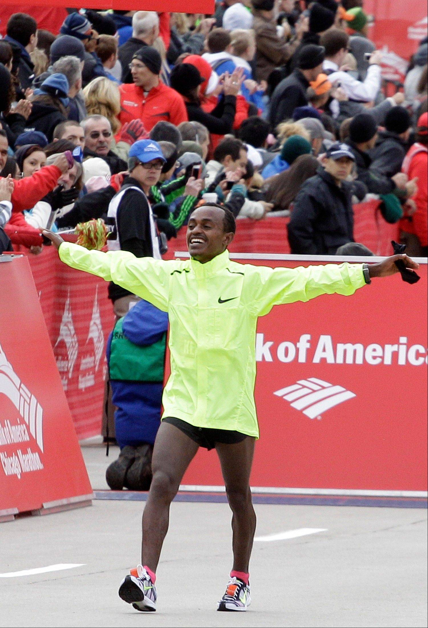 Tsegaye Kebede of Ethiopia, celebrates after winning the 2012 Chicago Marathon Sunday, Oct. 7, 2012.