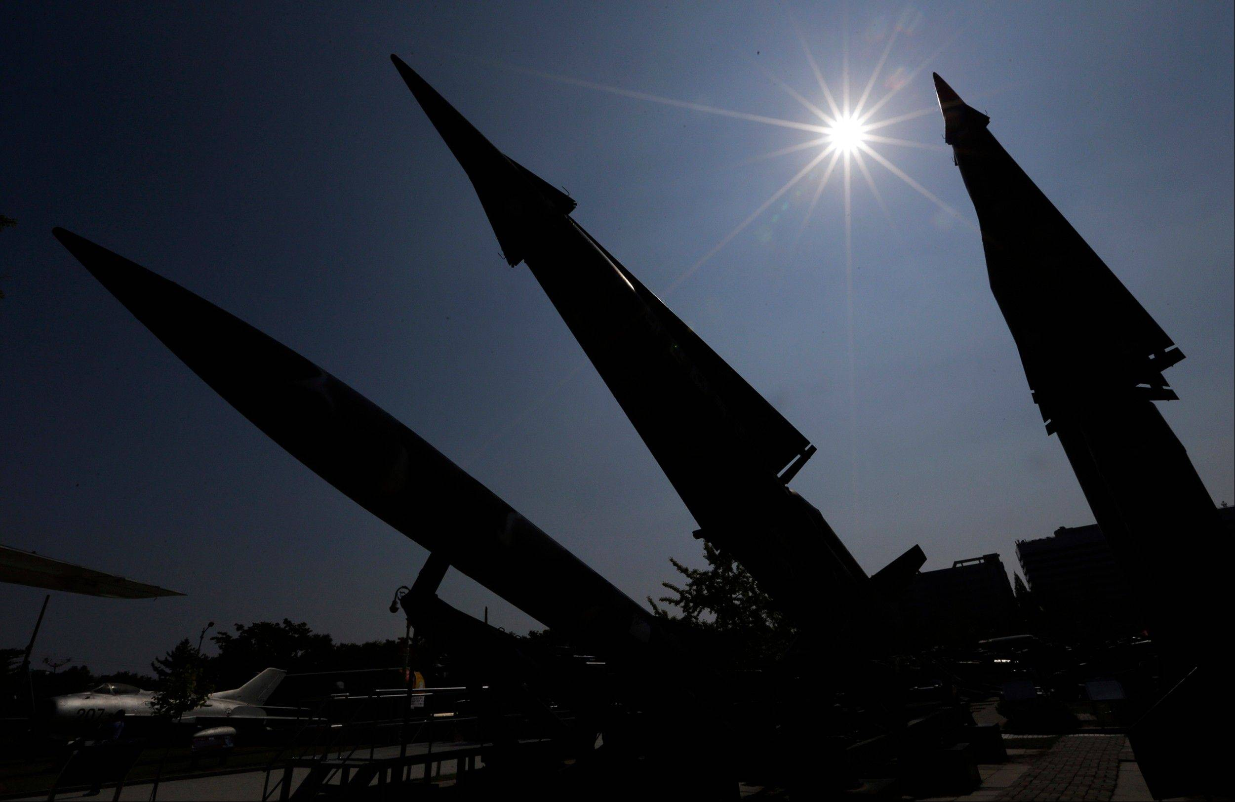 South Korean mock missiles are silhouetted at the Korea War Memorial Museum in Seoul, South Korea, Sunday, Oct. 7, 2012. South Korea said the U.S. has agreed to allow it to develop longer-range missiles that could strike all of North Korea.