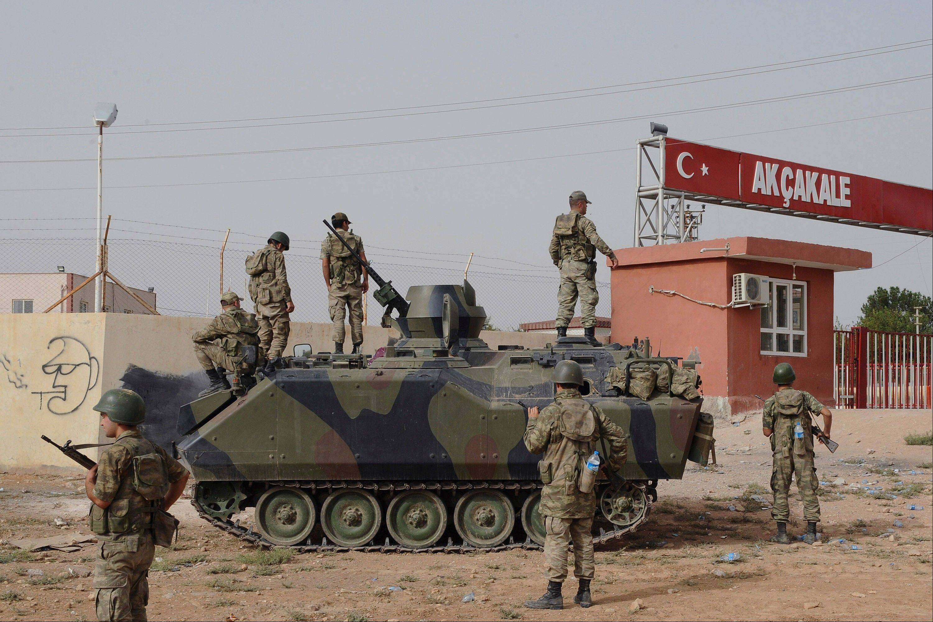 This is a Turkish military station at the border gate with Syria, across from Syrian rebel-controlled Tel Abyad town, in Akcakale, Turkey.