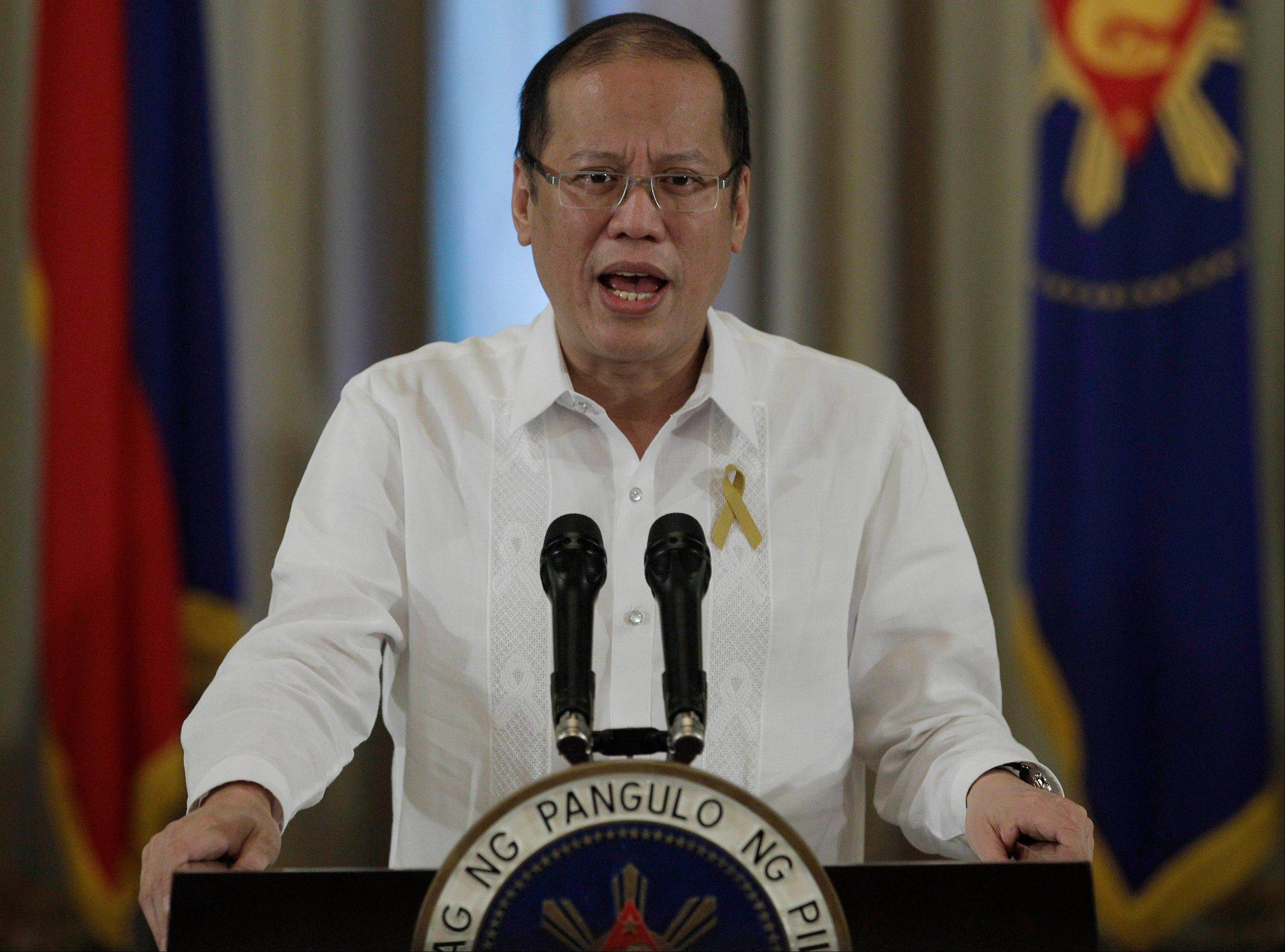 Philippine President Benigno Aquino III makes an announcement on national television Sunday at the Malacanang presidential palace in Manila. Aquino said Sunday that his government has reached a preliminary peace agreement with the nation's largest Muslim rebel group.