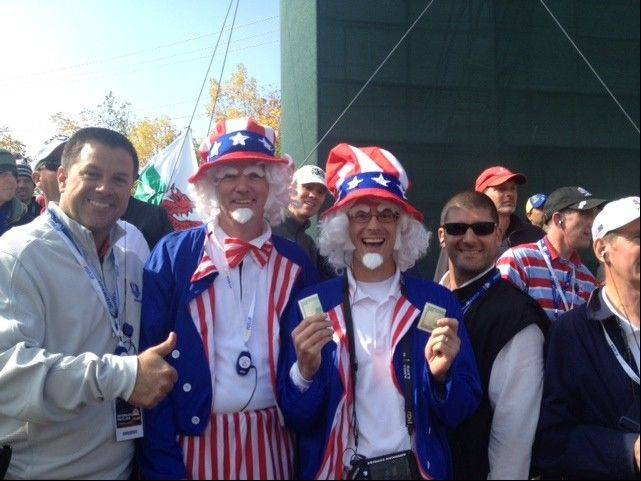 Joe Lundvick, left, chief operating officer of Perfection Global in Elk Grove Village, took photos with Team USA fans during the 39th annual Ryder Cup last weekend at Medinah Country Club.