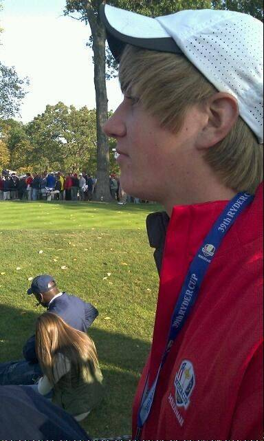 Nicholas Wittman sits at the 13th hole during the 39th annual Ryder Cup at Medinah Country Club last weekend. His father, Roselle Trustee Terrence Wittman, snapped this photo because Michael Jordan was sitting in the foreground.