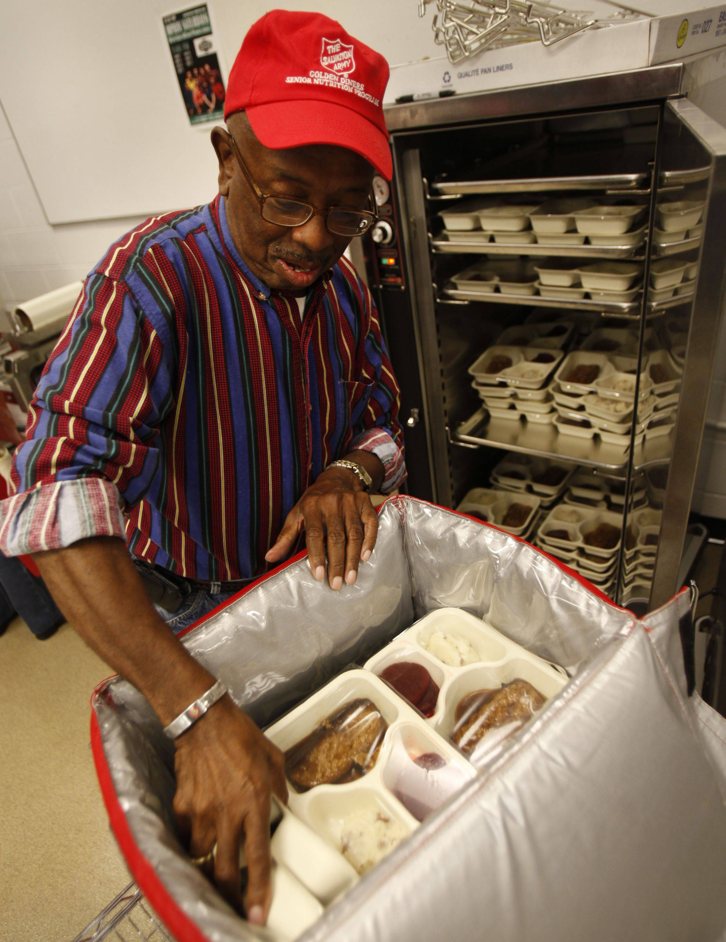 Employee Leslie Thomas of Elgin says his work with the program has opened his eyes to how many seniors live, and he gets satisfaction from the connections he makes.