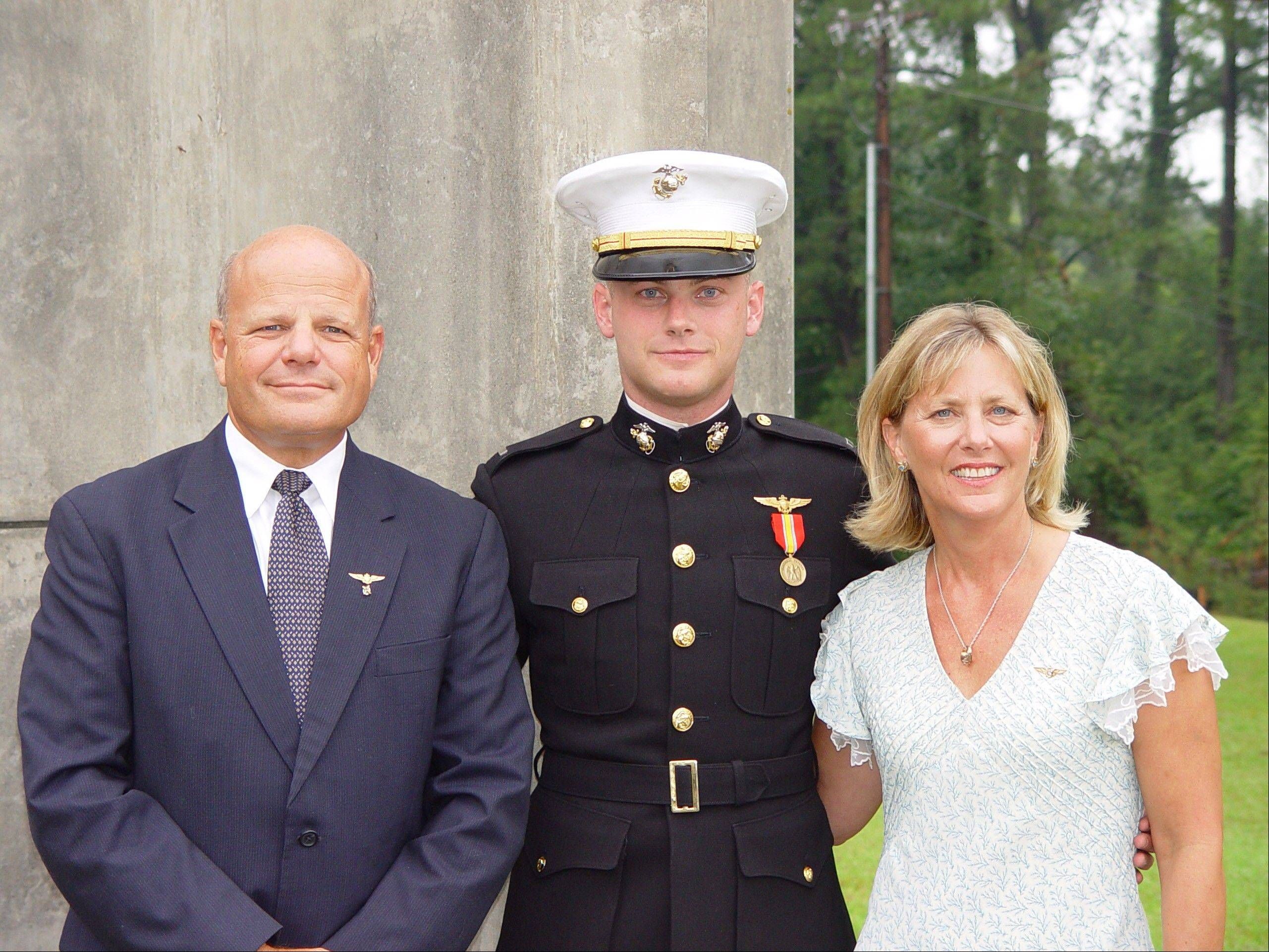 Lisa Freeman and her husband, Gary, and her son, Matthew, and in Meridian, Miss. where Matthew finished his jet training. Matthew Freeman excelled at everything he set his mind to. Eagle Scout, honor roll, student council president. So no one was surprised when he won an appointment to the U.S. Naval Academy, following in his father's footsteps.
