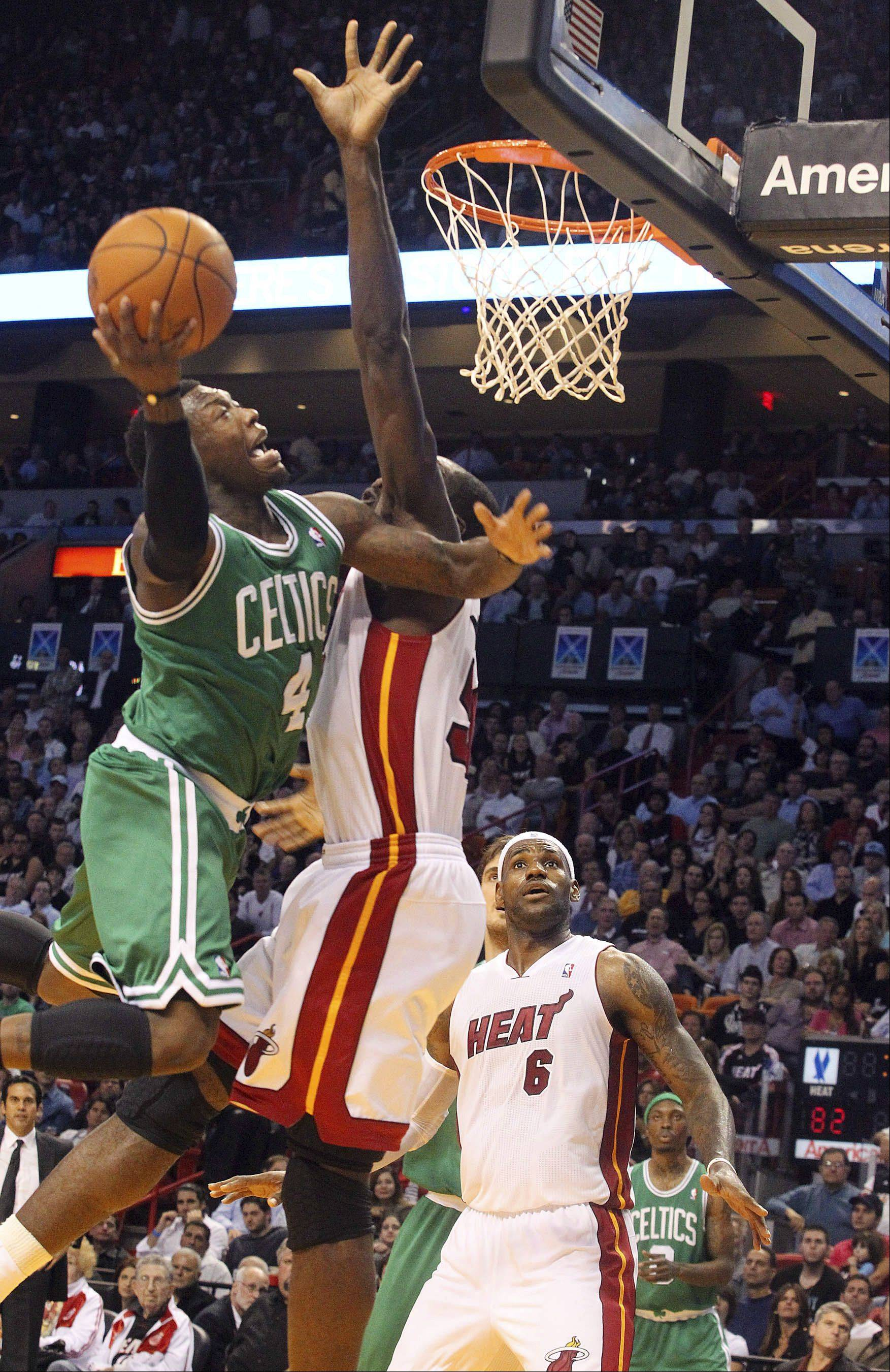 Boston Celtics' Nate Robinson goes to the basket against Miami Heat's Dwyane Wade during the third quarter of an NBA basketball game Thursday, Nov. 11, 2010, in Miami.