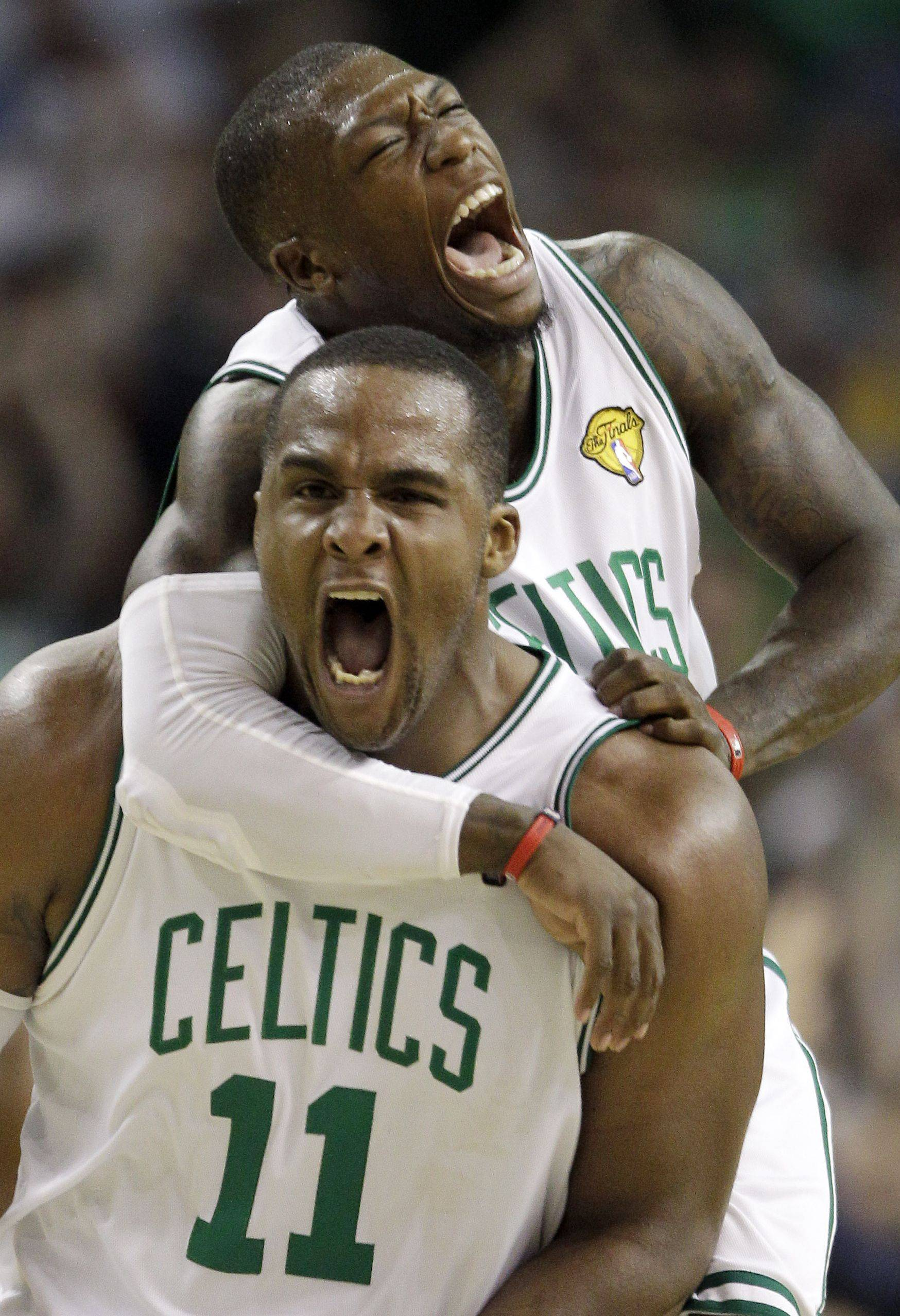 New Bulls point guard Nate Robinson, rear, celebrates with Glen Davis during the NBA Finals in 2010.