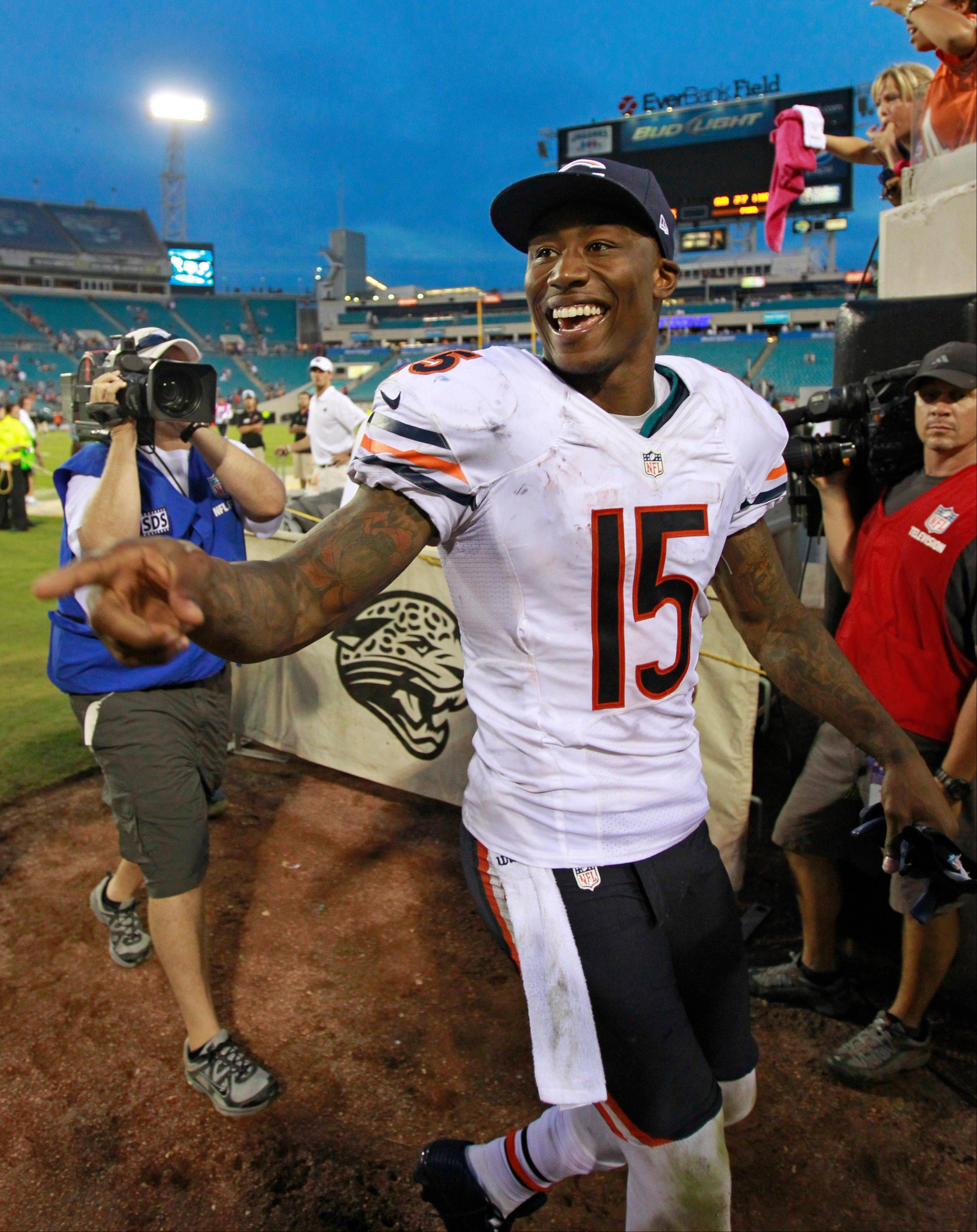 Bears receiver Brandon Marshall points to Bears fans as he comes off the field after defeating the Jacksonville Jaguars 41-3 in an NFL football game, Sunday, Oct. 7, 2012, in Jacksonville, Fla.