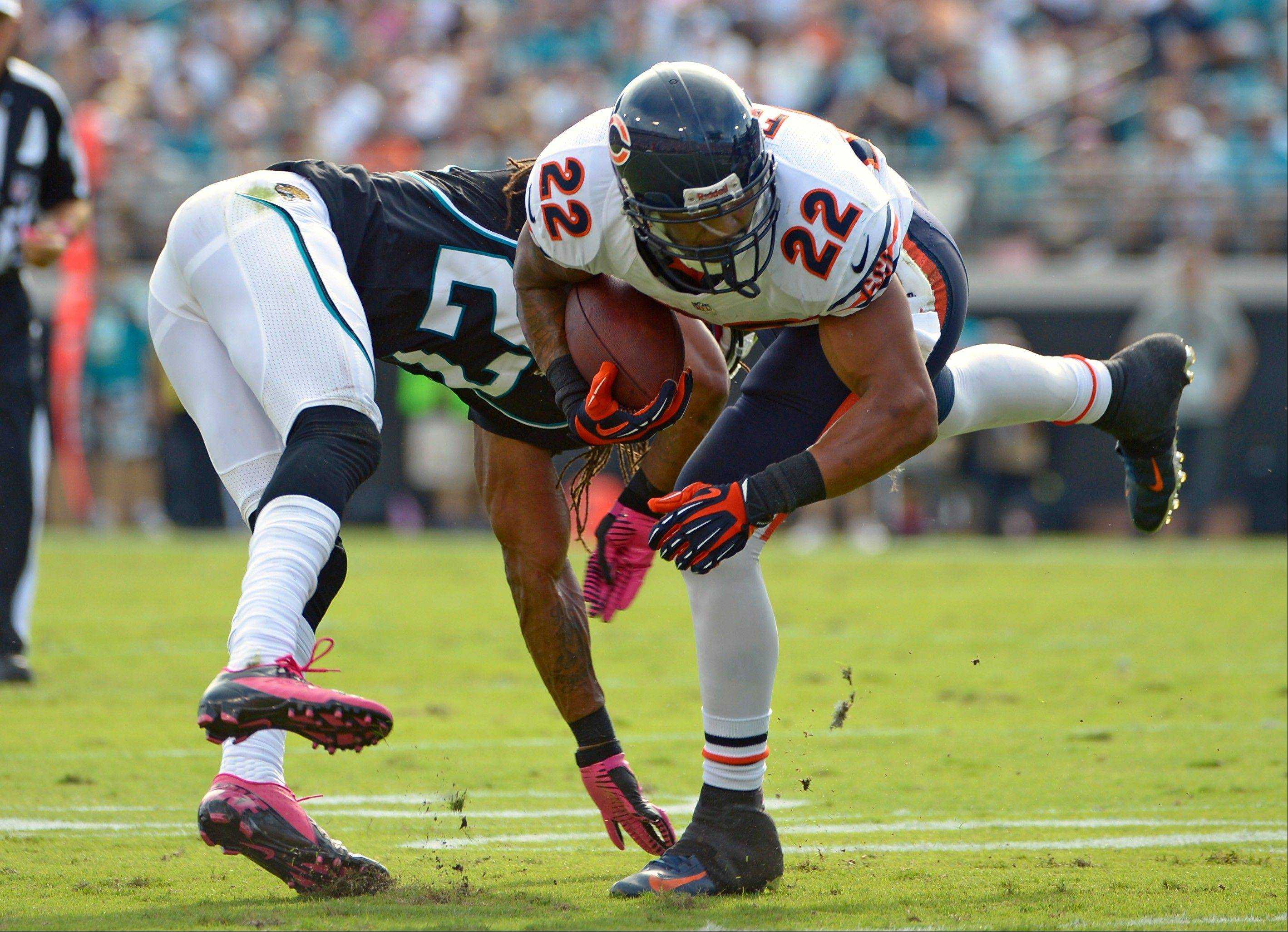 Chicago Bears running back Matt Forte is upended by Jacksonville Jaguars cornerback Rashean Mathis during the first half of an NFL football game, Sunday, in Jacksonville, Fla.