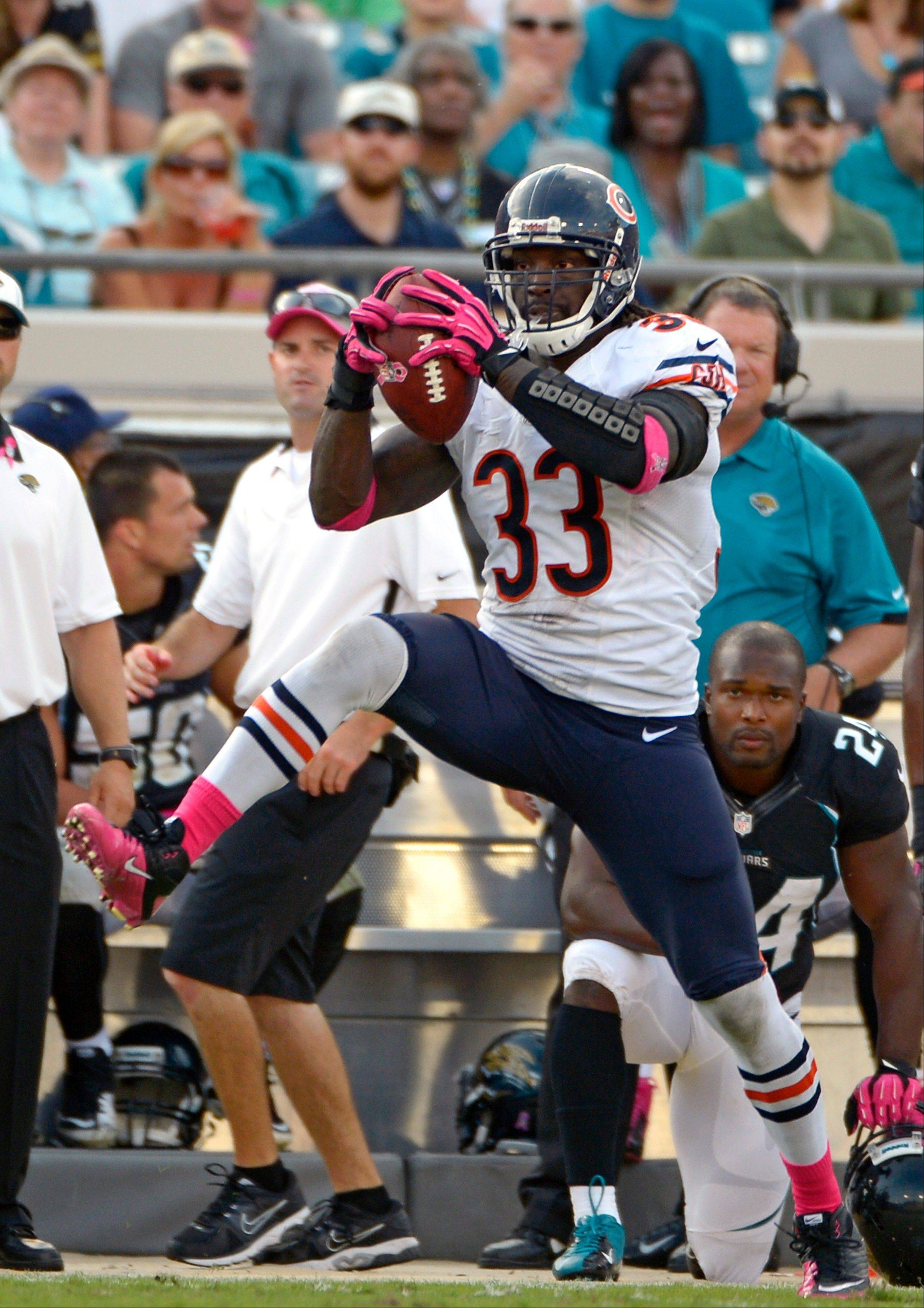 Chicago Bears cornerback Charles Tillman intercepts a Jacksonville Jaguars pass before running it back for a 36-yard touchdown during the second half, Sunday, in Jacksonville, Fla.