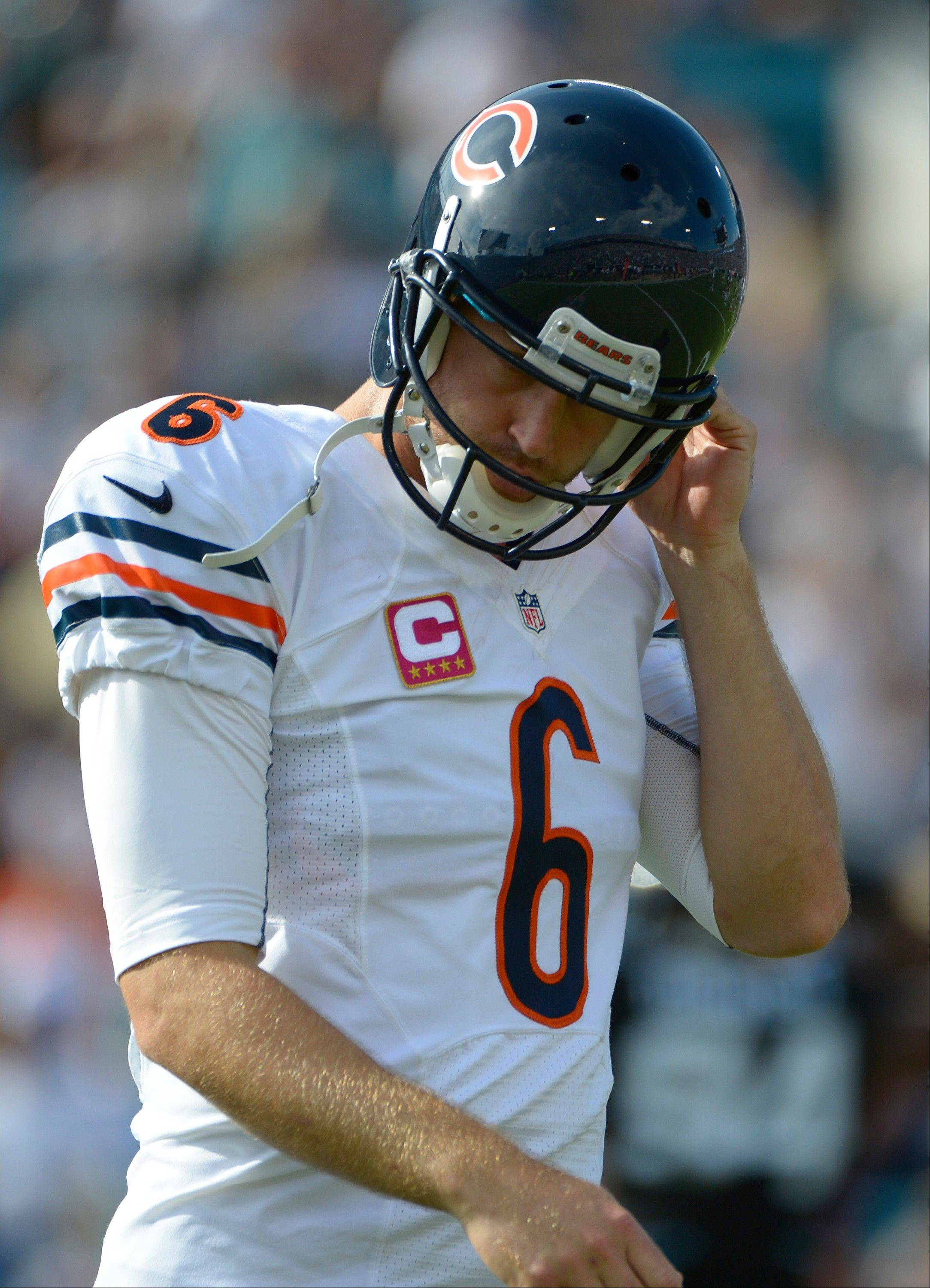 Chicago Bears quarterback Jay Cutler walks off the field after throwing an interception against the Jacksonville Jaguars during the first half, Sunday, in Jacksonville, Fla.