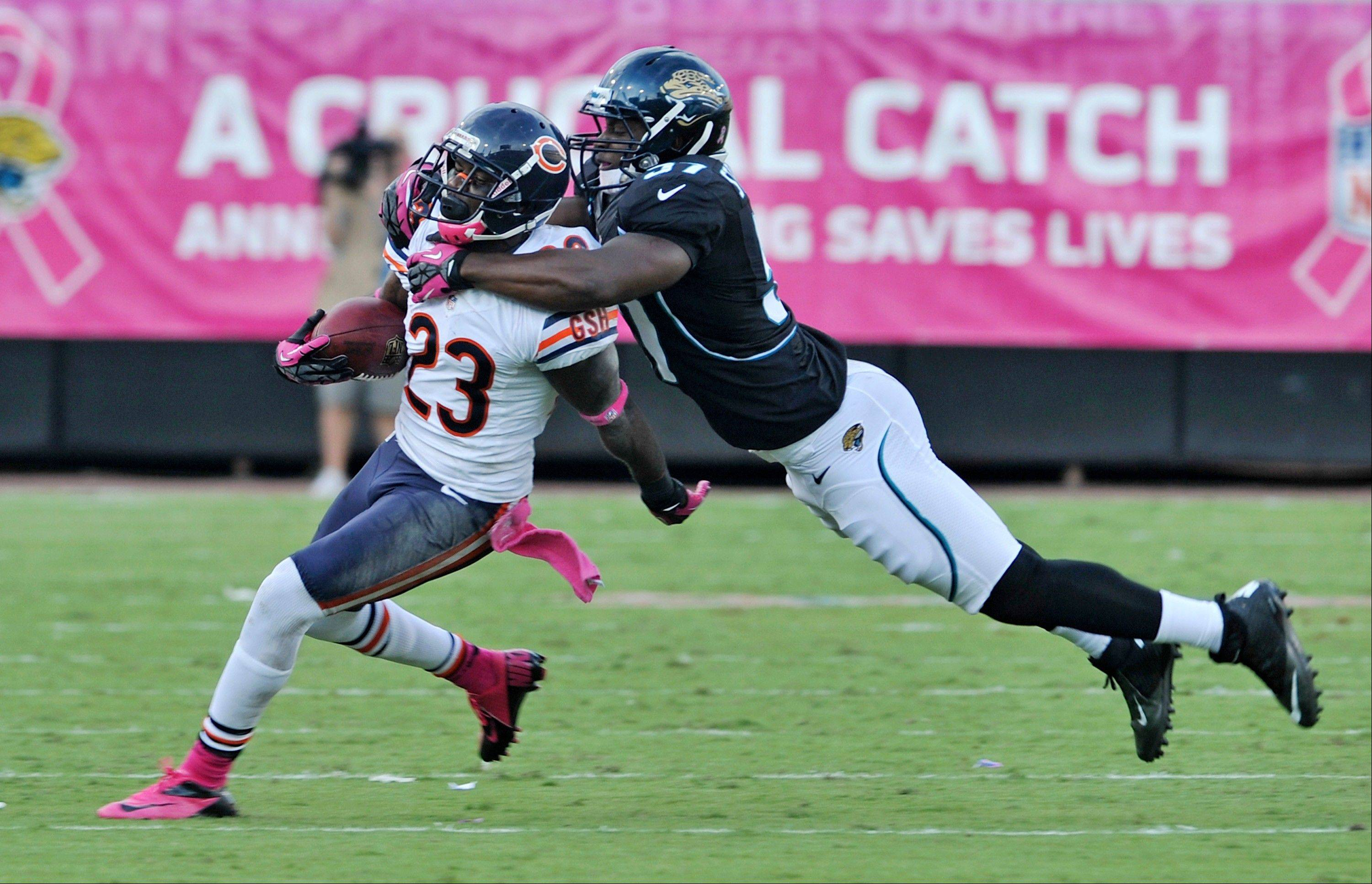 Chicago Bears wide receiver Devin Hester is brought down by Jacksonville Jaguars linebacker Julian Stanford after a reception during the second half, Sunday, in Jacksonville, Fla.