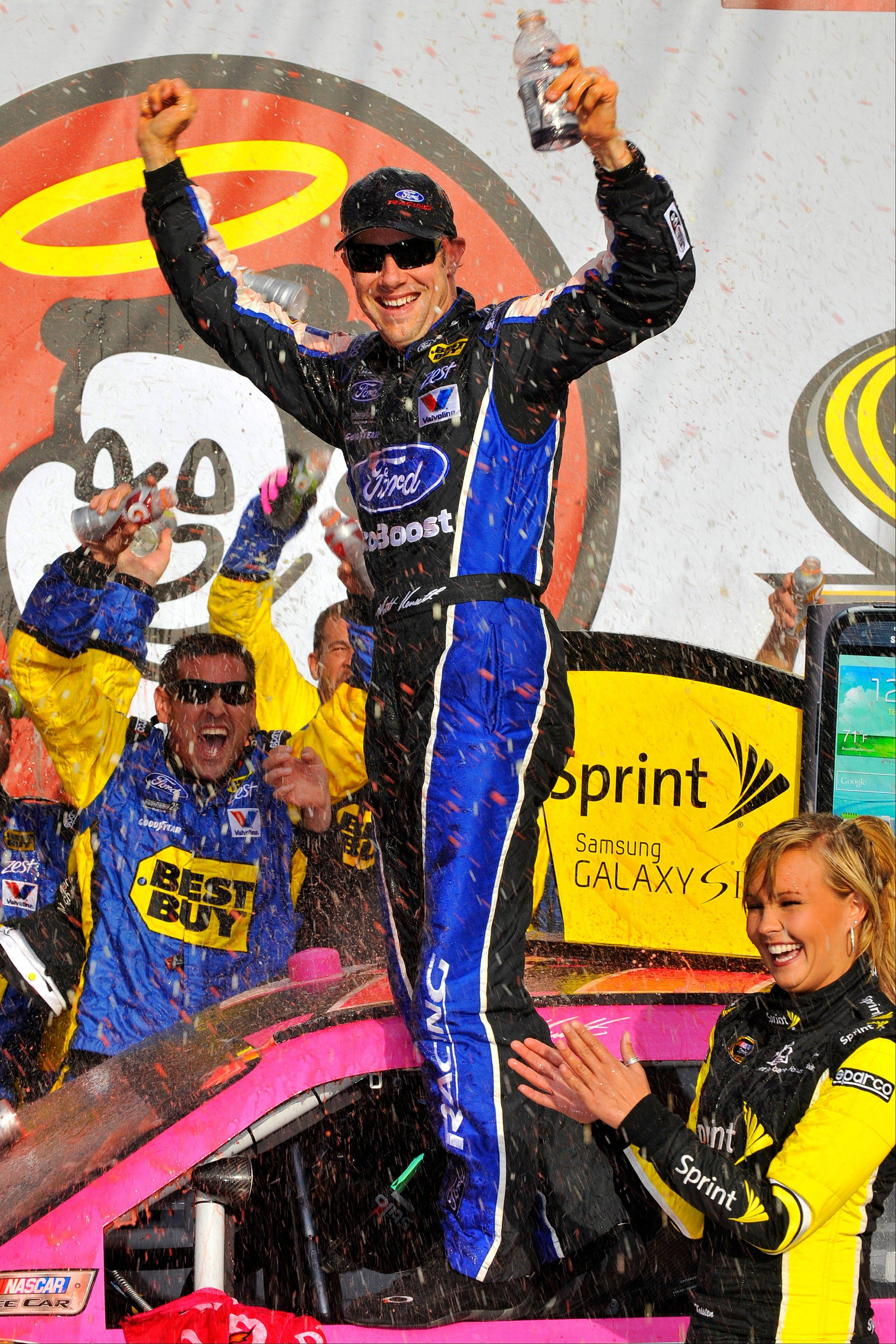 Matt Kenseth stands on his car in victory lane Sunday after winning the NASCAR Sprint Cup Series auto race at Talladega Superspeedway in Talladega, Ala.