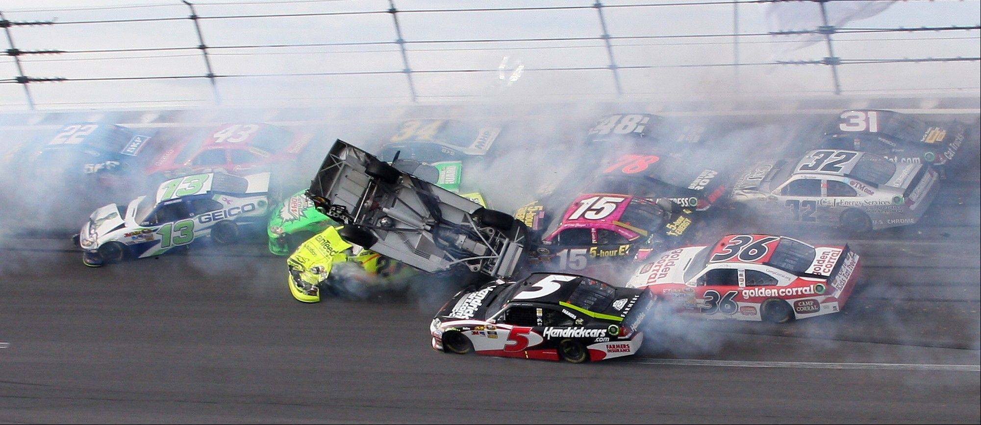 Tony Stewart (14) flips over as Kasey Kahne (5), Clint Bowyer (15), Dave Blaney (36), Terry Labonte (32), Regan Smith (78), Jeff Burton (31), Jimmie Johnson (48) crash around him during the NASCAR Sprint Cup race Sunday in Talladega, Ala. Also involved in the wreck were Paul Menard (27), Casey Mears (13), Aric Almirola (43), Dale Earnhardt Jr. (88), David Ragan (34) and Sam Hornish Jr. (22).