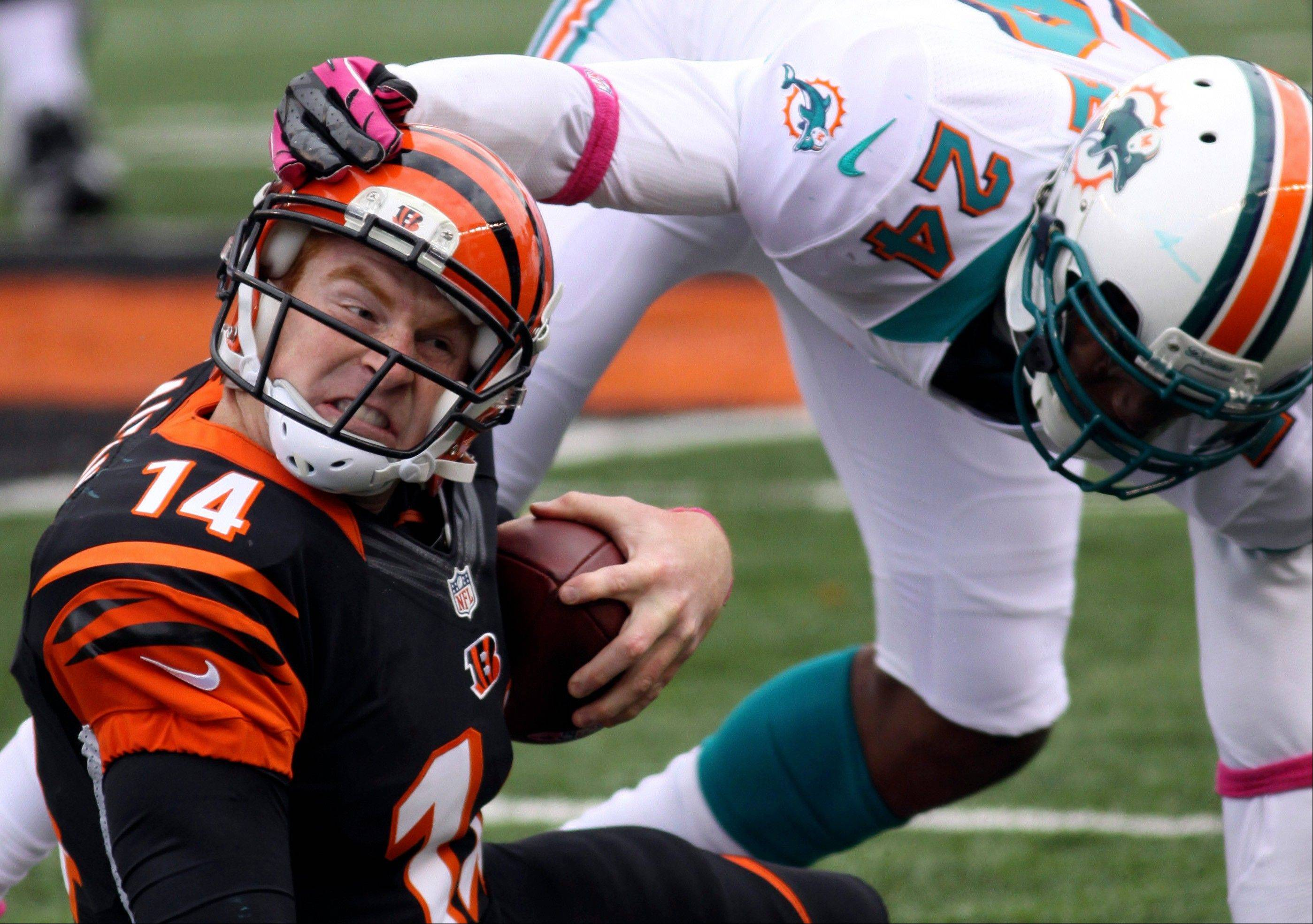 Dolphins cornerback Sean Smith tackles Bengals quarterback Andy Dalton after a short gain in the second half Sunday in Cincinnati.