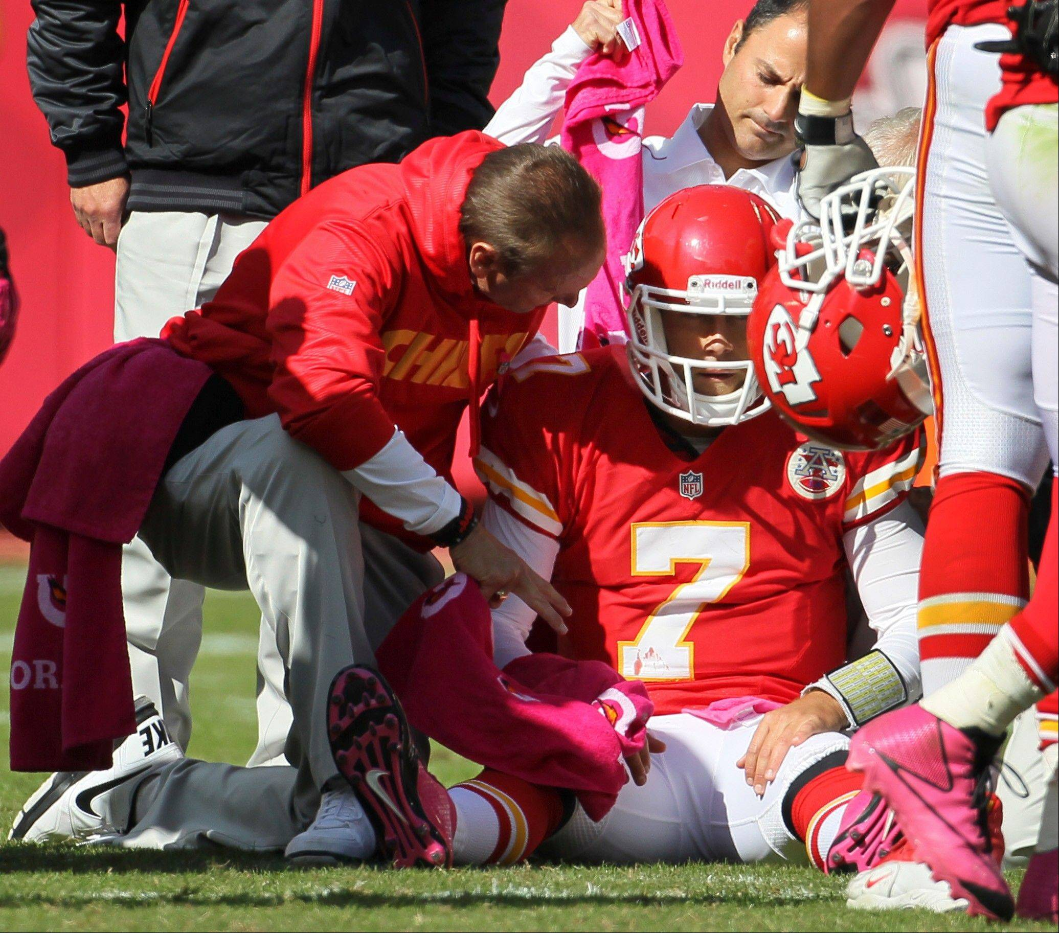 Trainers assist Chiefs quarterback Matt Cassel during the second half Sunday against the Baltimore Ravens at Arrowhead Stadium in Kansas City, Mo. The Ravens defeated the Chiefs 9-6.