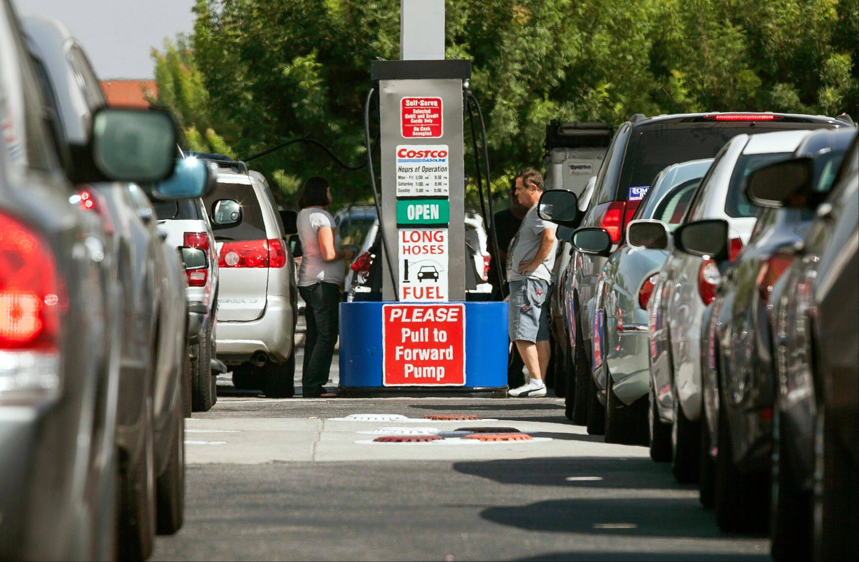 Costco members fill up with discounted gasoline at a Costco gas station in Van Nuys, Calif., Friday. Californians woke up to a shock Friday as overnight gasoline prices jumped by as much as 20 cents a gallon in some areas.