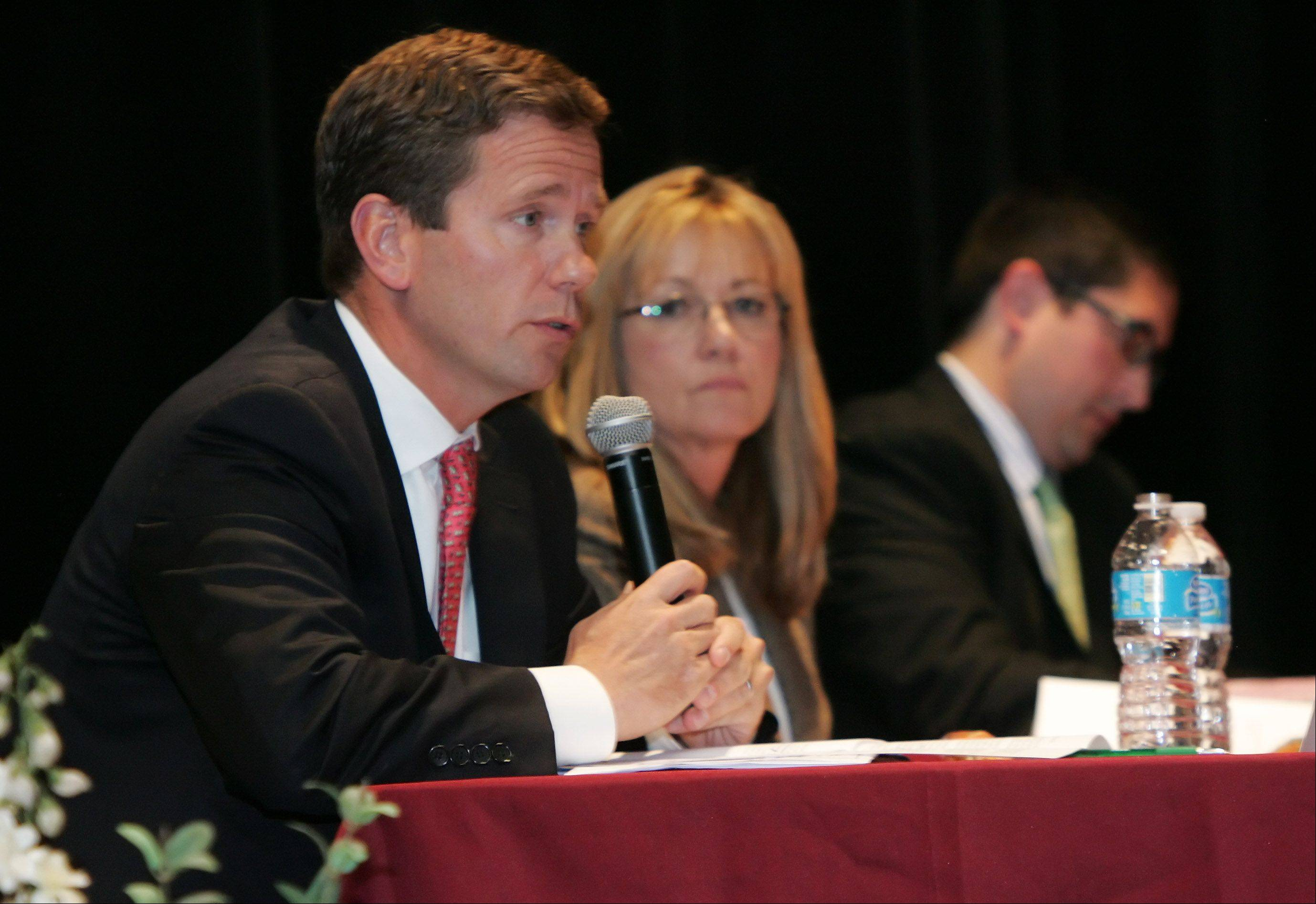 U.S. Congressman Robert Dold addresses the audience about the 10th Congressional District election during the candidate forum Sunday at the Round Lake Beach Cultural & Civic Center. The event was sponsored by the League of Women Voters and the Round Lake Area Public Library. To his right are Melinda Bush, candidate for the 31st state Senate seat, and Sam Yingling, who is running for the 62nd state House seat.