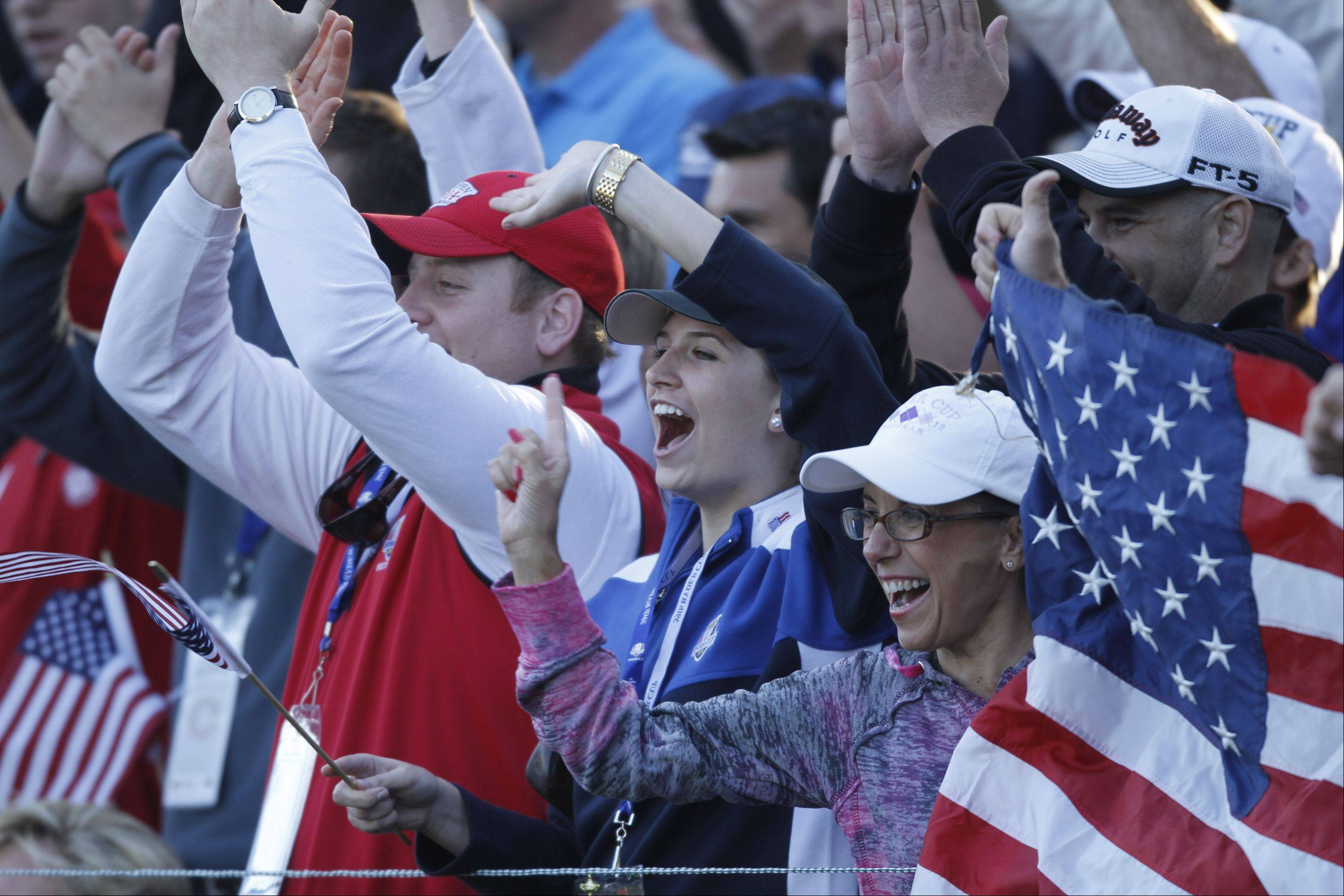Fans cheer on the US team as Phil Mickelson and Keegan Bradley approach the 17th green Friday afternoon at the 2012 Ryder Cup at Medinah Country Club.
