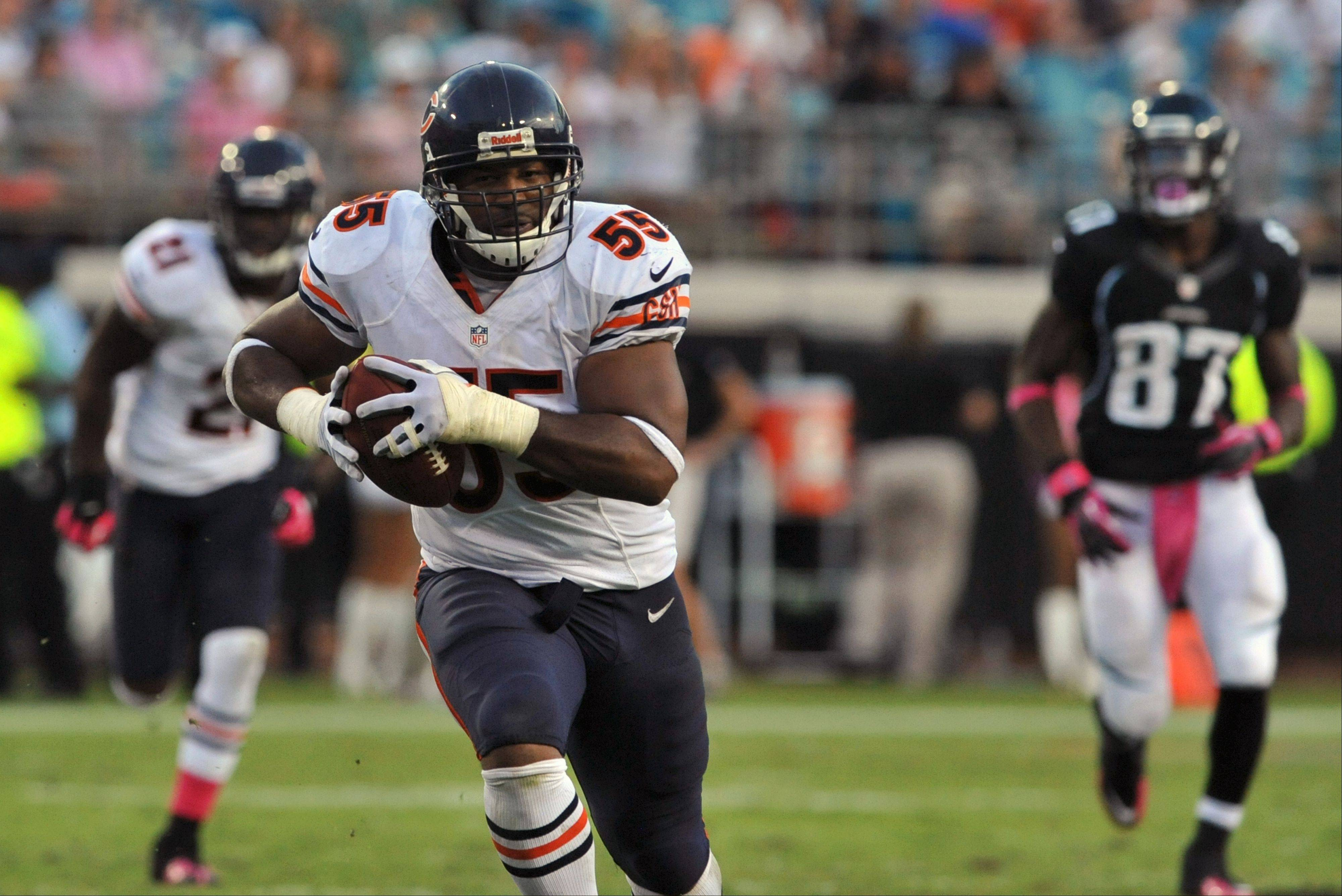 Bears linebacker Lance Briggs runs back an interception for a touchdown during Sunday�s victory at Jacksonville. The Bears have scored 5 touchdowns on interception returns during their three-game winning streak.