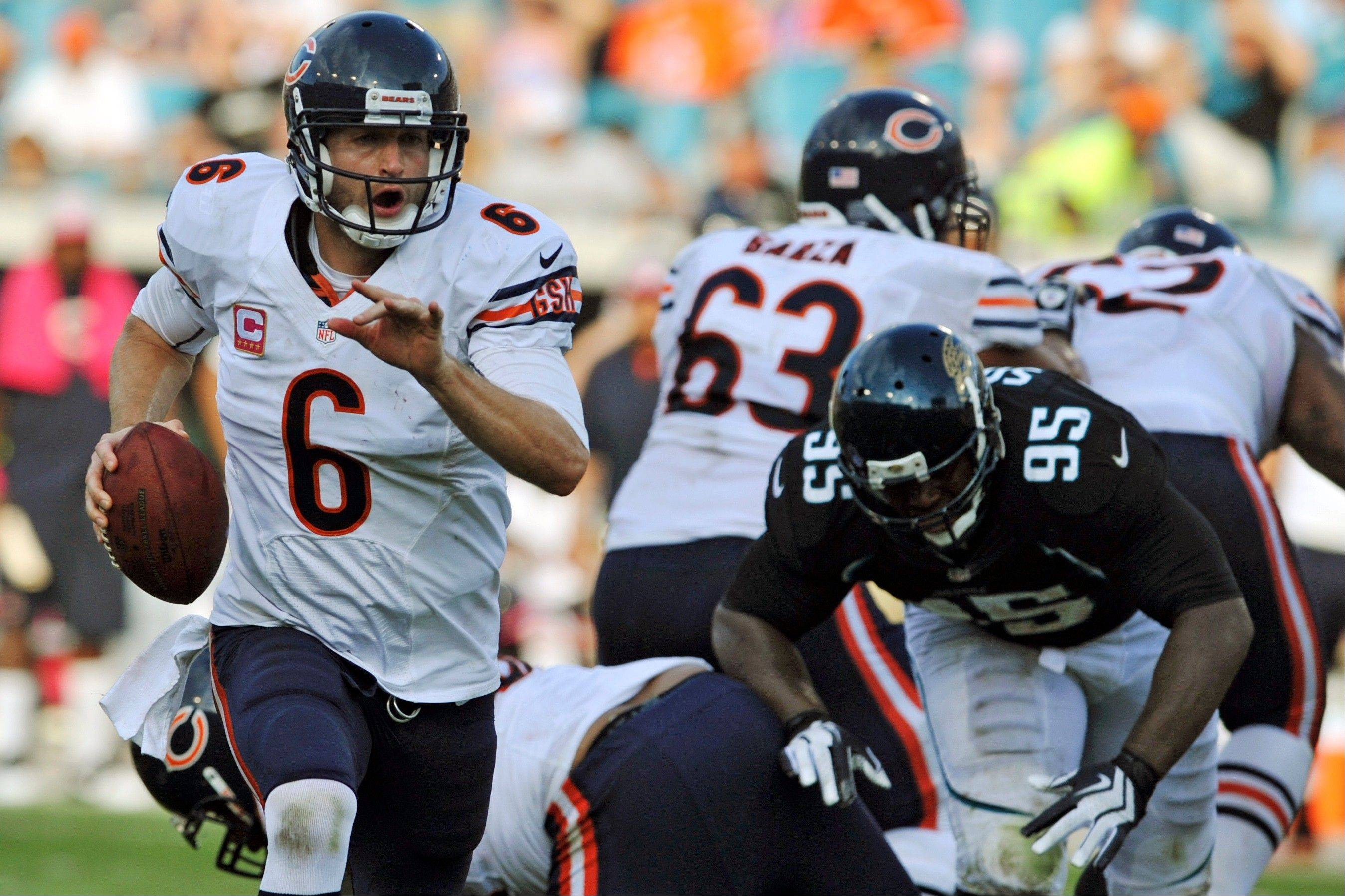 Jay Cutler (6) runs from the pocket as he is pressured by Jacksonville Jaguars defensive tackle D�Anthony Smith (95) during the second half of an NFL football game, Sunday, Oct. 7, 2012, in Jacksonville, Fla. The Bears won 41-3.