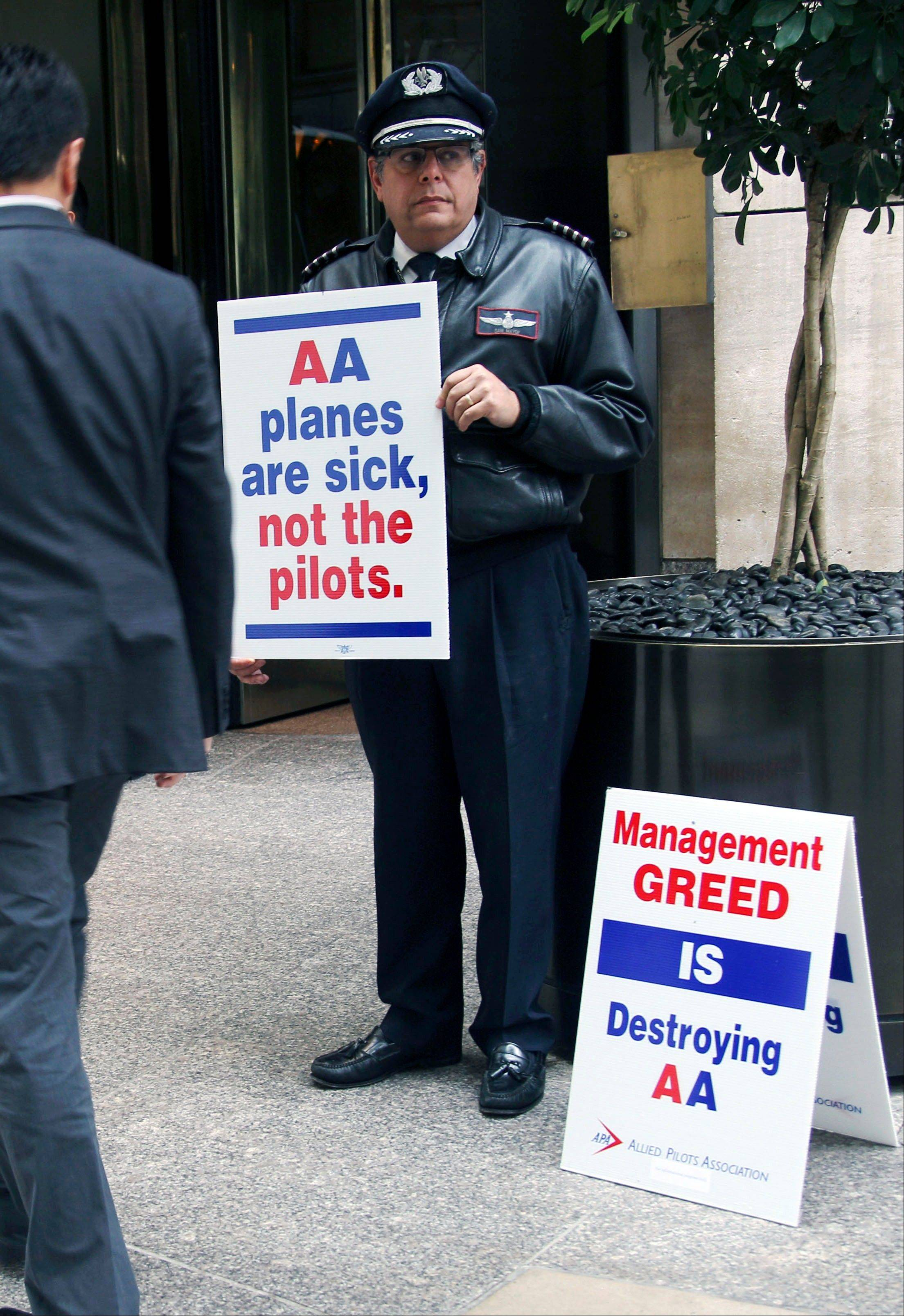 American Airlines pilot Sam Mayer pickets in front of a hotel where American Airlines CEO Tom Horton held a meeting with reporters, in New York, Monday, Oct. 8, 2012. In September, American Airlines saw a 7.1 percent drop in domestic passengers and its on-time performance fell to 59 percent, below other big airlines. The drop is attributed to pilots who are writing up extra maintenance requests as part of an unsanctioned job action. If that wasn't bad enough, seats on three separate flights came loose.