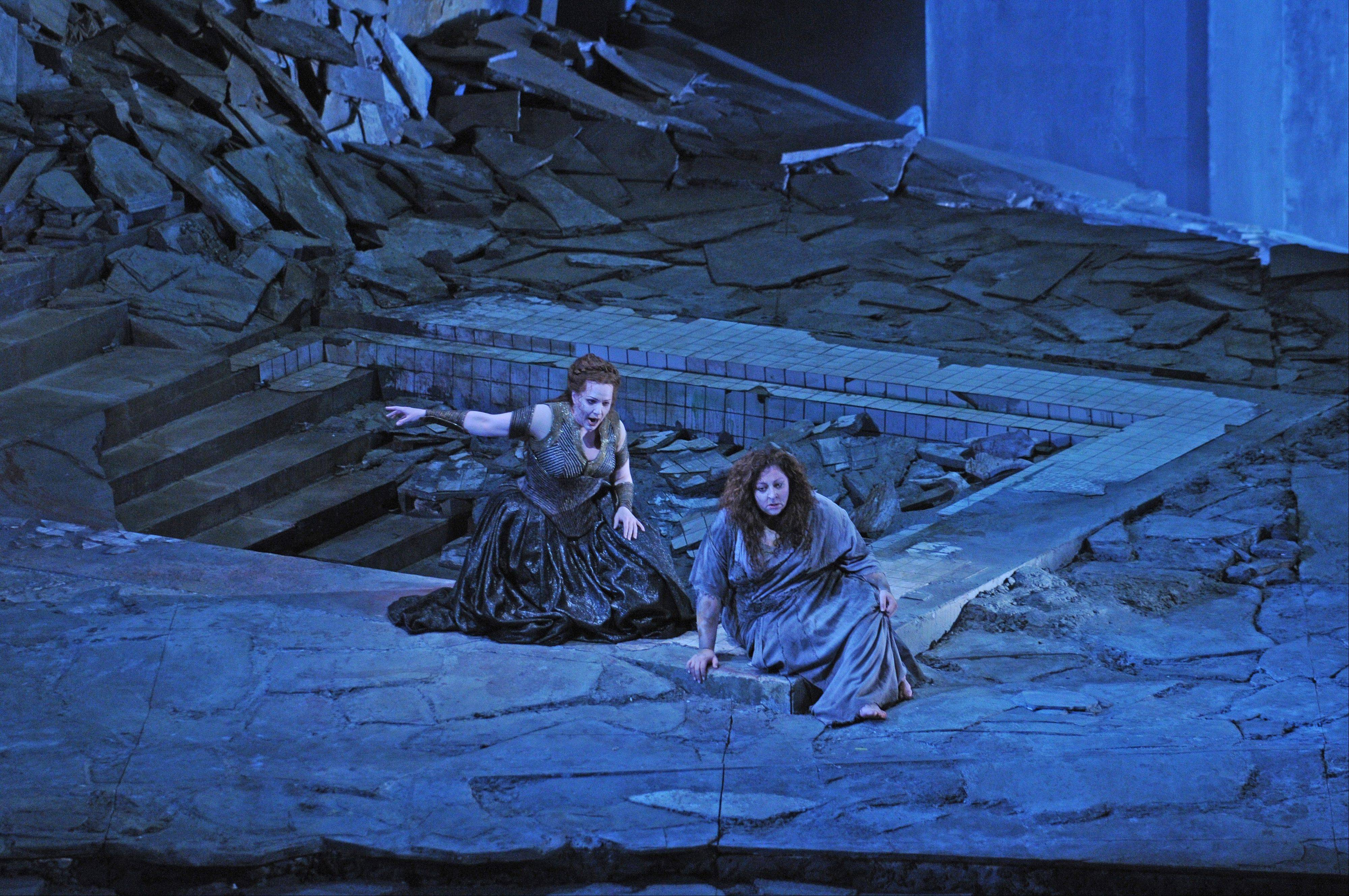 "Chrysothemis (Emily Magee) warns Elektra (Christine Goerke) that their mother plans to lock her defiant daughter in a dark tower in the Lyric Opera of Chicago's new production of ""Elektra."" The 1909 opera by Richard Strauss and Hugo von Hofmannsthal opened the Lyric's 2012-13 season."