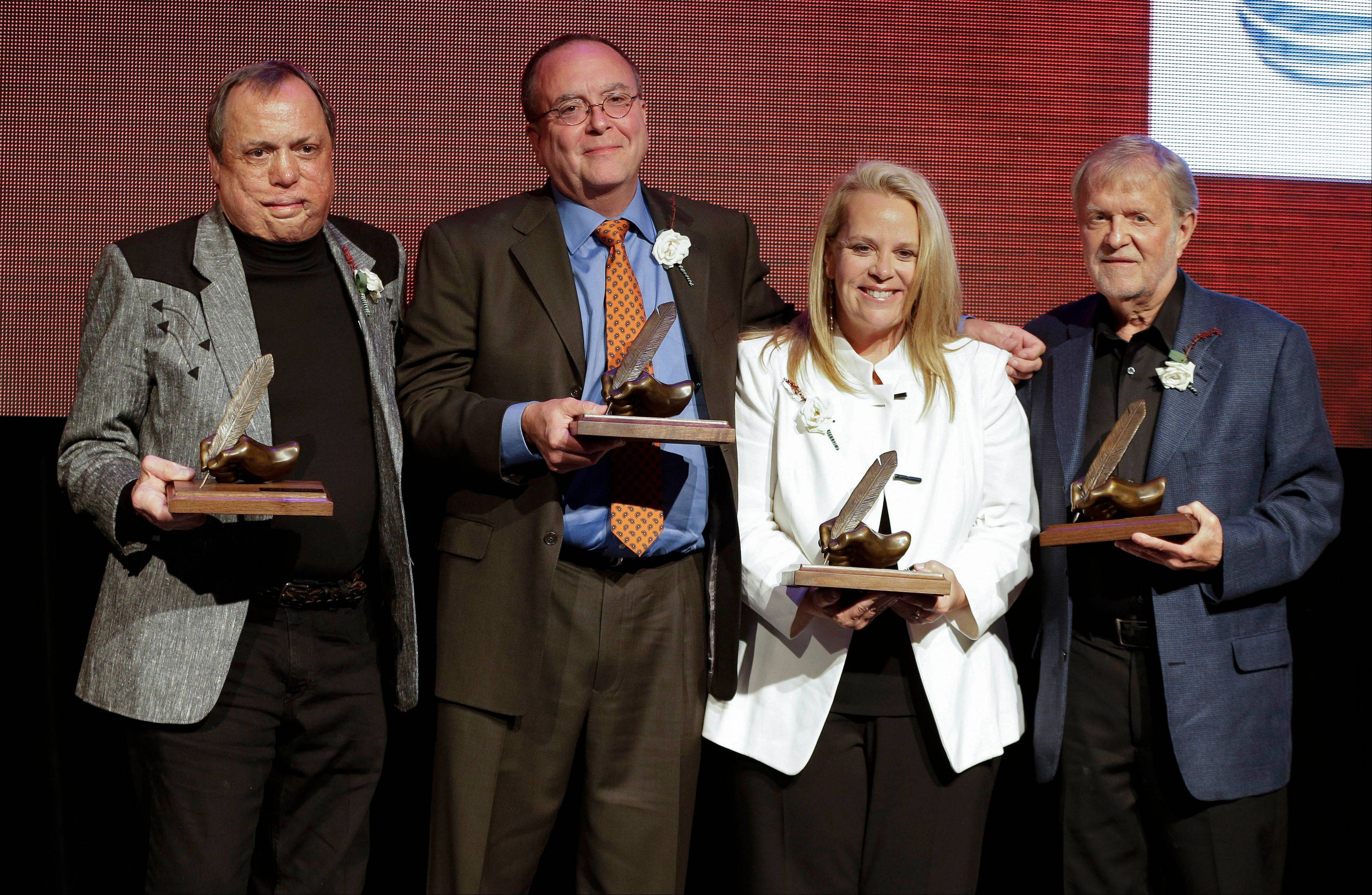Kim Williams, left, Tony Arata, Mary Chapin Carpenter and Larry Henley were inducted into the Nashville Songwriters Hall of Fame on Sunday in Nashville, Tenn.
