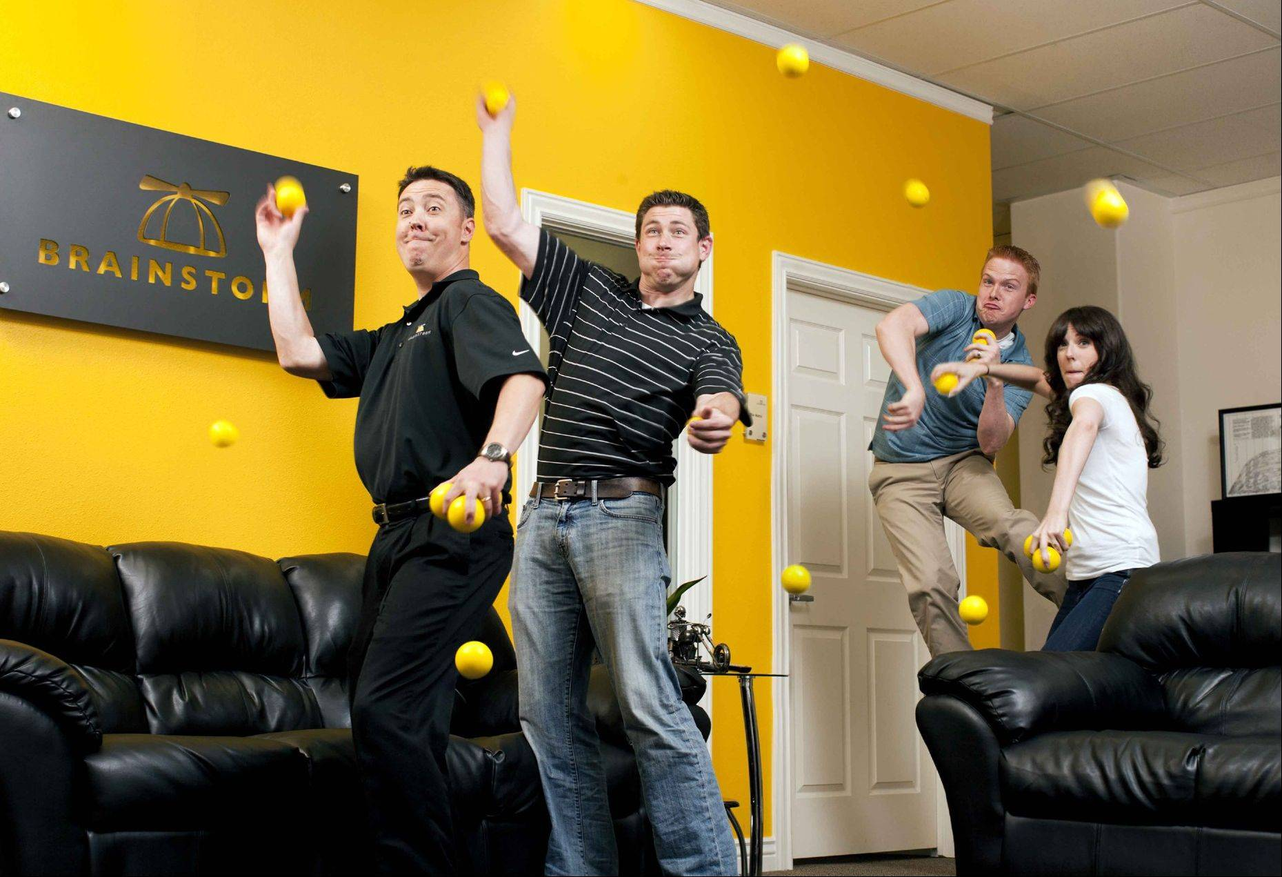 Tyler Rogers, from left, David Grimsman, Jason Eggett and Jourdan Strain enjoy a light moment tossing balls to relieve stress. BrainStorm strives to keep a lively, and inspiring office atmosphere, and sometimes that includes random events like dodgeball, dance-offs, crab walk races and more.