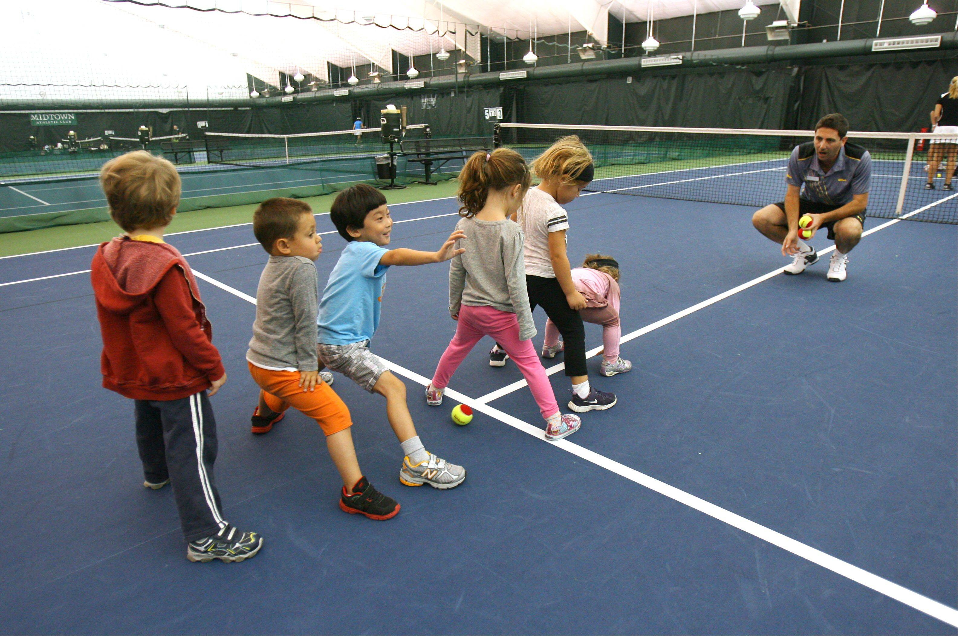 """Don't let the dragon hit your feet,"" instructor Jarrod Diepraam says during Midtown Athletic Club's tennis program for toddlers in Bannockburn. Tennis Explorers blends physical activities, tennis skills and storytelling in an on-court environment."