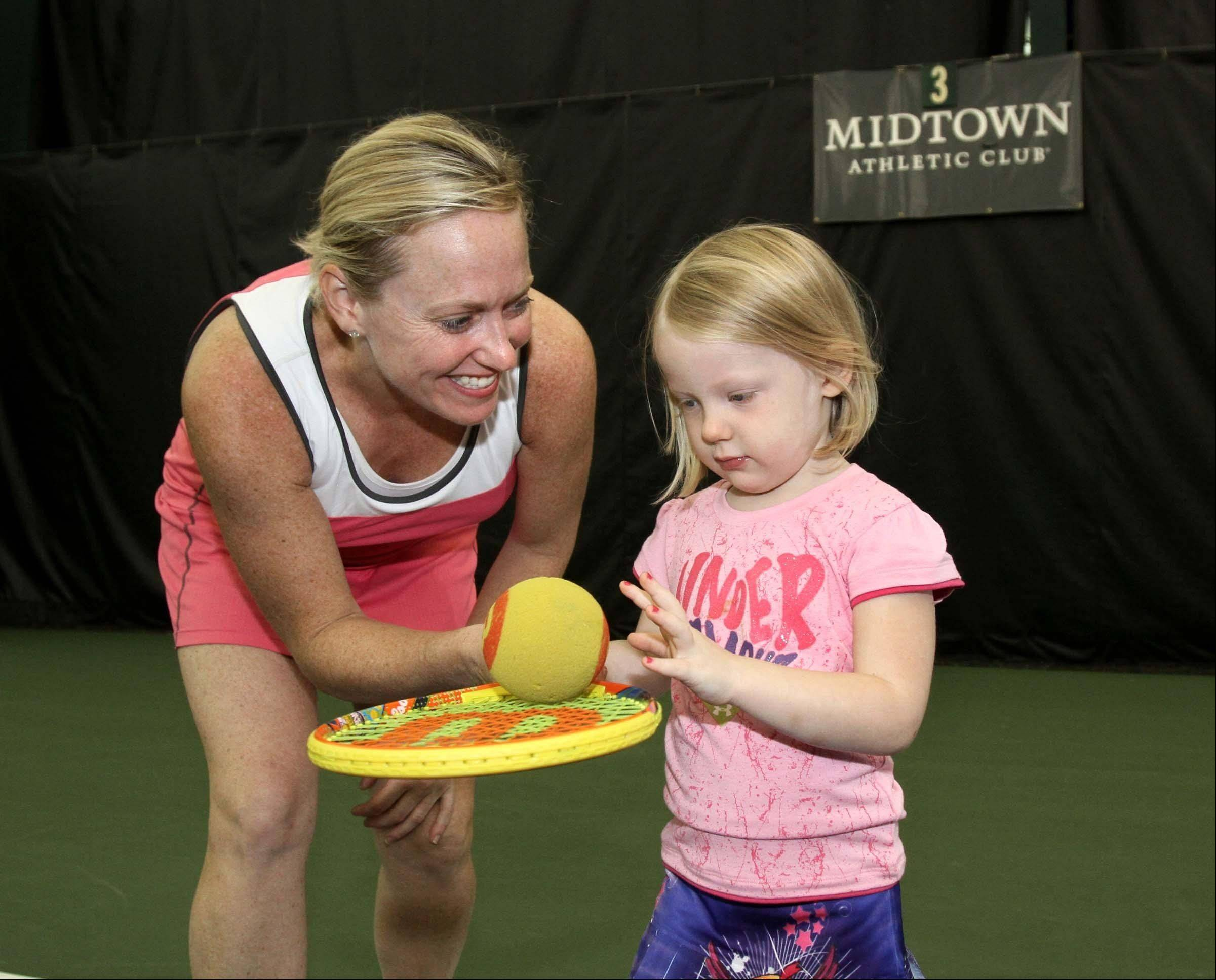 Johanna Croll of Barrington and her 3-year-old daughter Courtney take part in Midtown Athletic Club's toddler tennis program, Tennis Explorers.