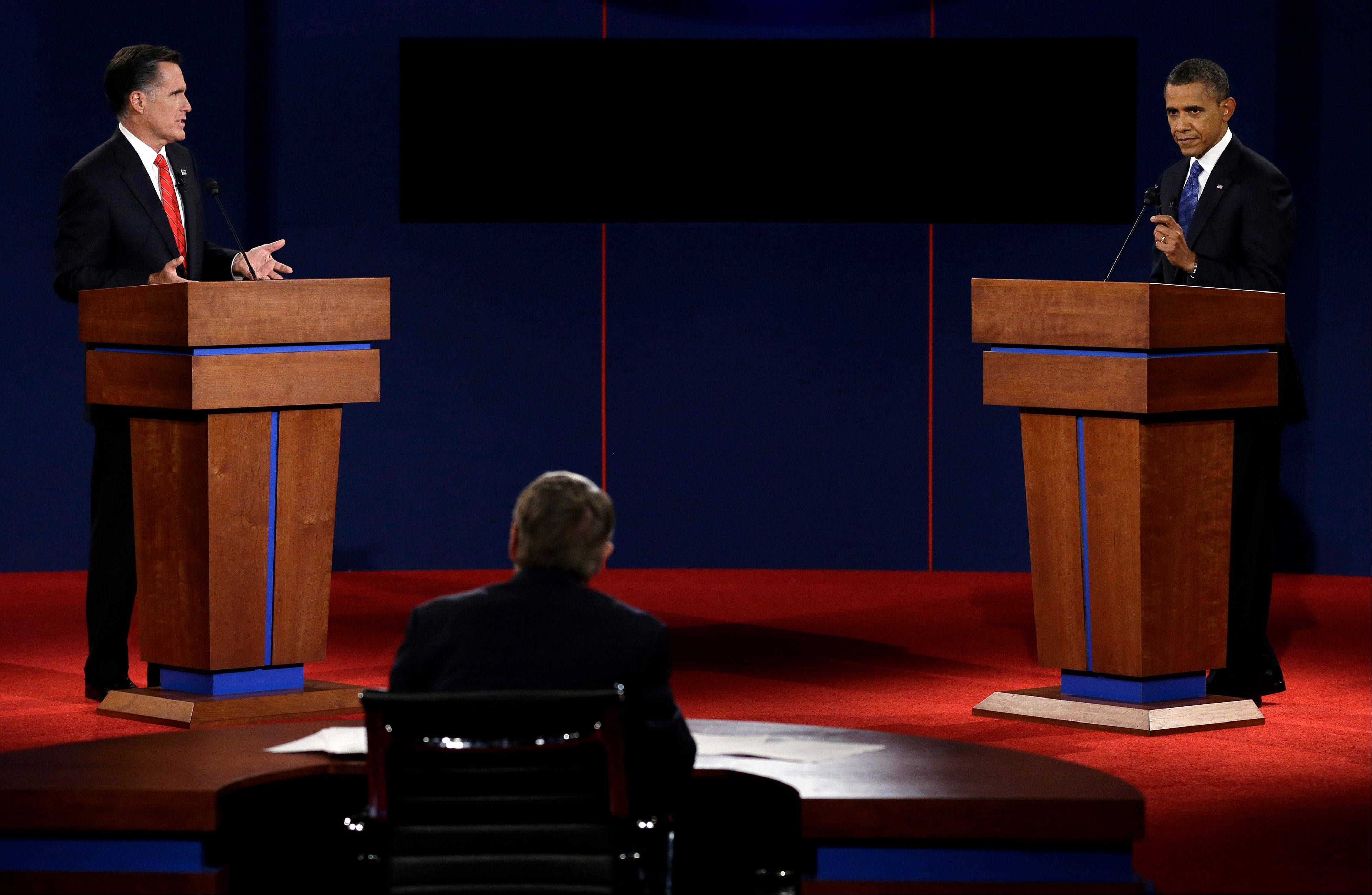 Republican presidential candidate and former Massachusetts Gov. Mitt Romney and President Barack Obama participate in the first presidential debate Oct. 3 at the University of Denver, in Denver. Jim Lehrer, center, served as moderator.