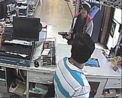 Police say surveillance video captured the armed robbery at a Schaumburg store.