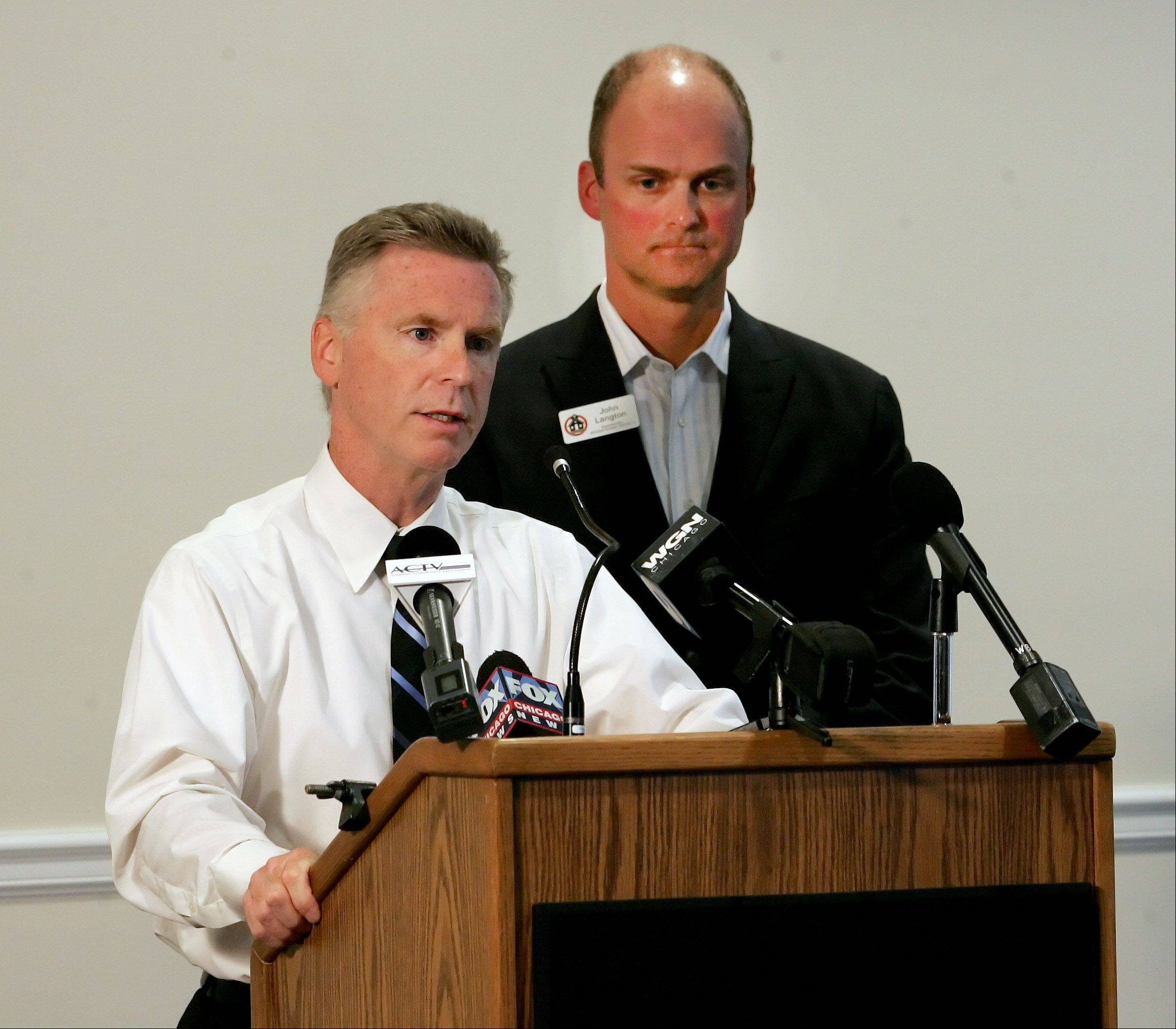 Addison Police Director Bill Hayden, left, and Addison Elementary District 4 Superintendent John Langton announce at a news conference Monday that a girl who claimed she was restrained in a junior high school bathroom admitted she made up the story.
