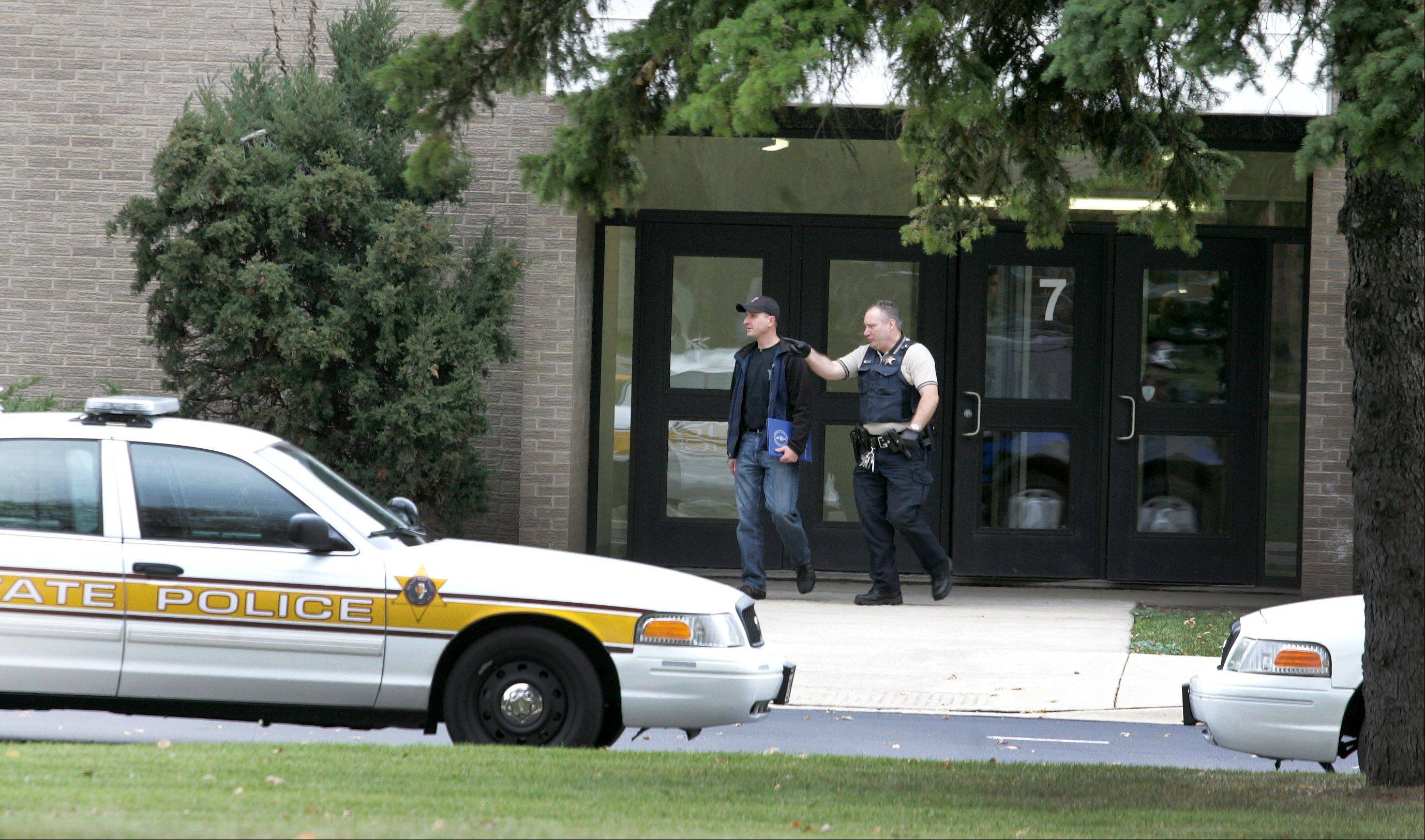 Police exit Indian Trail Junior High School in Addison while investigating what proved to be a false report Friday that a student was restrained in the restroom by an intruder. The student fabricated the story, police said.