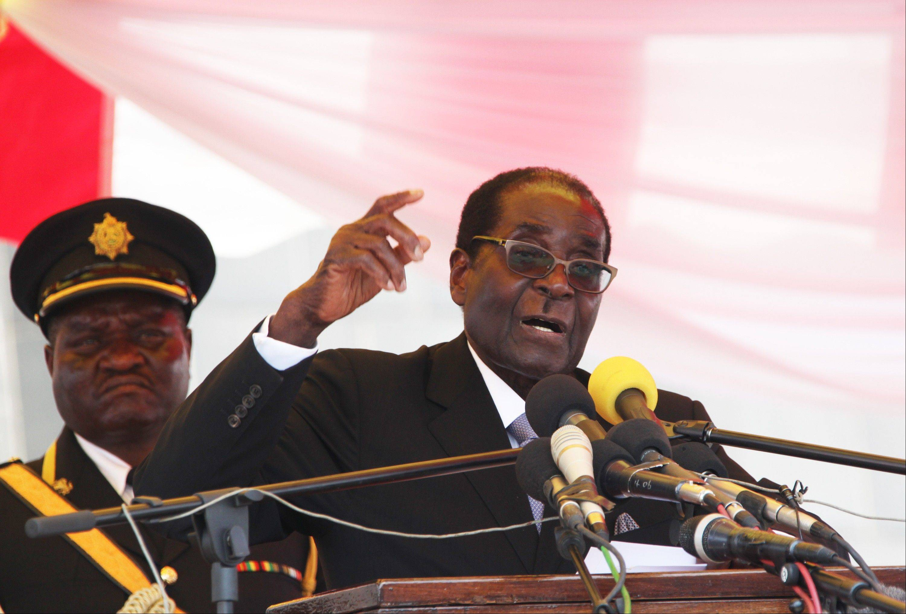 Zimbabwe President Robert Mugabe makes a speech at the state burial of a former foreign minister Stan Mudenge, in Harare, Monday. Mugabe says he wants his people to be tolerant of each other's views to allow for a free vote in proposed elections.