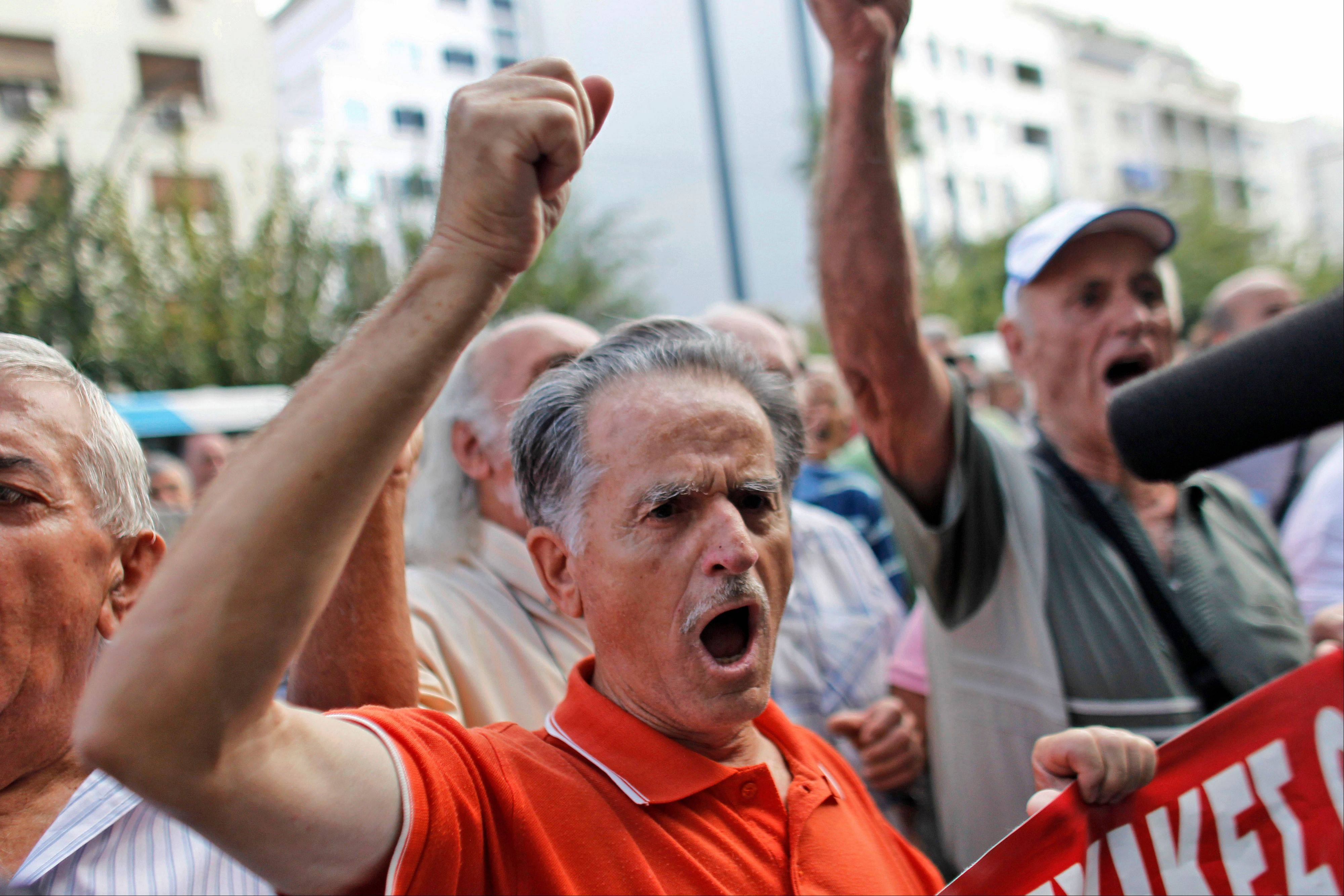 A pensioner shouts slogans during an anti-austerity protest in front of the EU headquarters in Athens on Monday. Greek police have increased security and are preparing to close down large sections of the capital Athens to contain protests against Germany's Chancellor, Angela Merkel, who is visiting the city Tuesday.