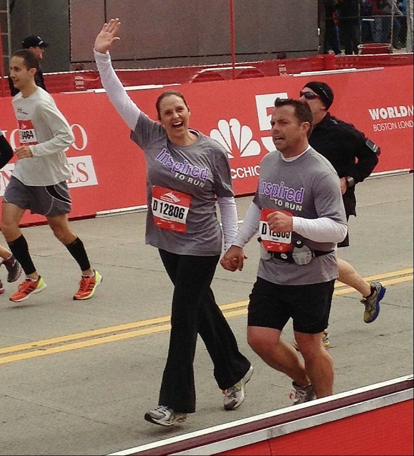 Kirk and Beth Disrude, of Mundelein, ran in the Bank of America Chicago Marathon on Sunday. He suffered a stroke 13 months ago.