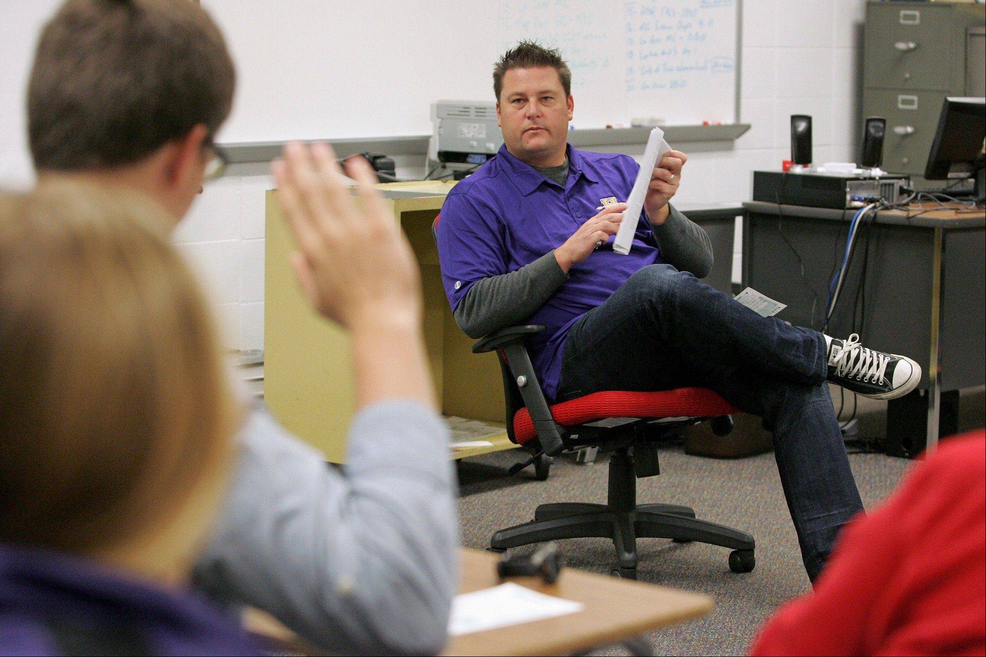 History teacher James Sabathne reviews a test with students during an Advanced Placement U.S. History class at Hononegah High School in Rockton. A group of educators has been redesigning the framework of the AP U.S. History course for the last five years.