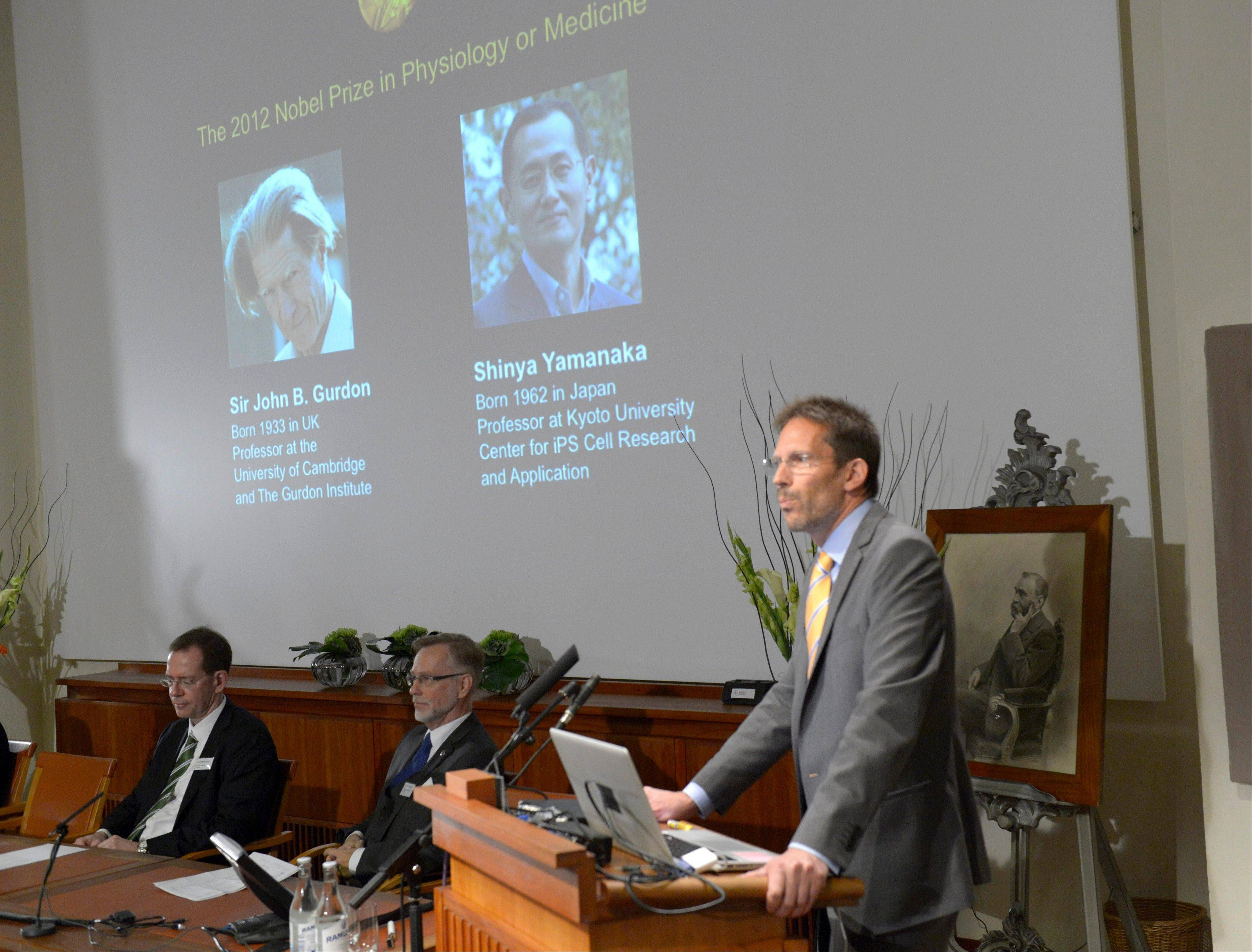 Thomas Perlmann of Karolinska Institute presents Sir John B. Gurdon of Britain and Shinya Yamanaka of Japan as winners of the 2012 Nobel Prize in medicine or physiology, in Stockholm, Monday.