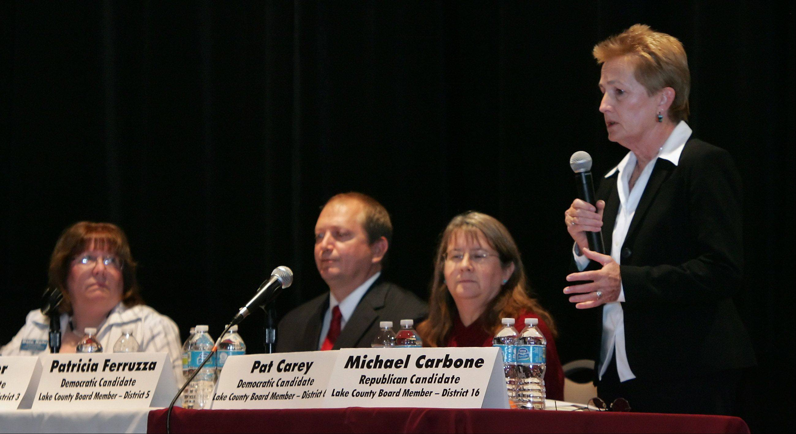 Lake County board member Pat Carey, right, speaks to the audience with candidates Patricia Ferruzza, Tom Weber and Dale Kehr during the candidate forum Sunday at the Round Lake Beach Cultural & Civic Center. The event was sponsored by the League of Women Voters and the Round Lake Area Public Library.