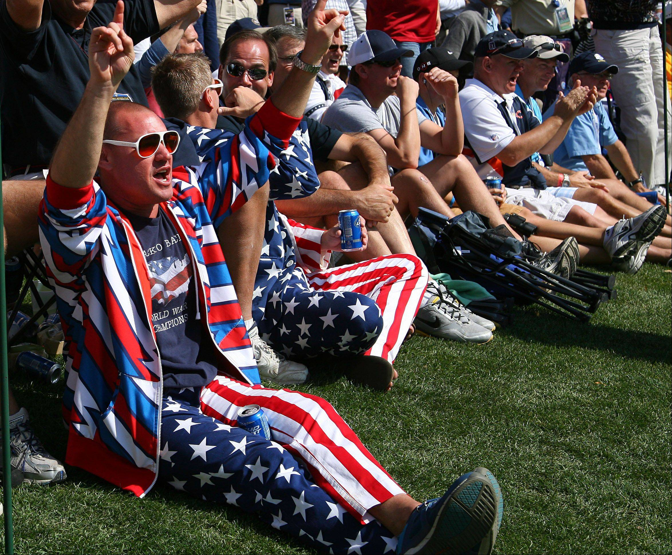 Fans sport their flag outfits on the 17th green during the morning matches on day 2 of the Ryder Cup at Medinah Country Club Saturday.