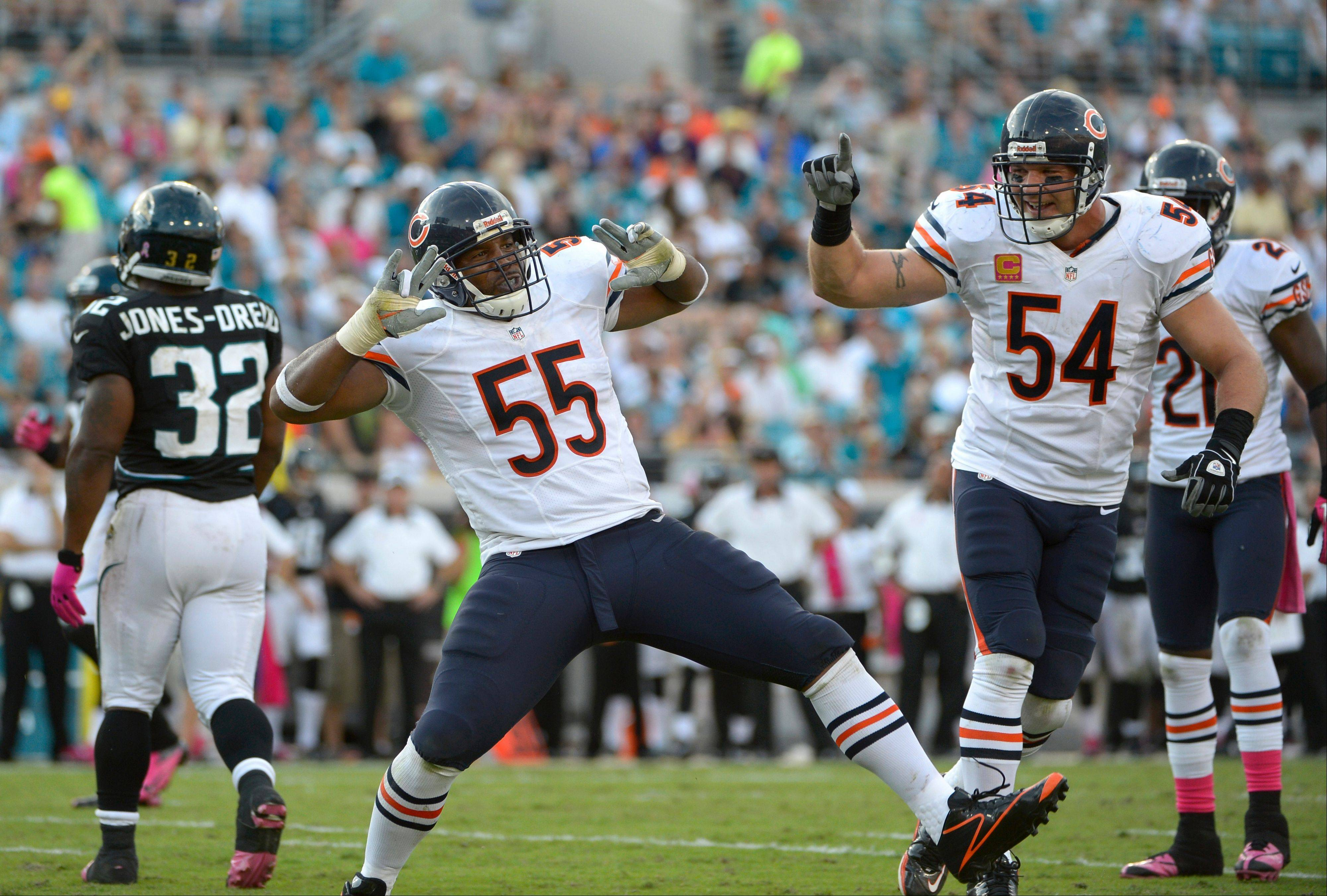Chicago Bears outside linebacker Lance Briggs (55) and middle linebacker Brian Urlacher (54) celebrate after Briggs sacked Jacksonville Jaguars quarterback Blaine Gabbert during the second half of an NFL football game in Jacksonville, Fla., Sunday, Oct. 7, 2012. The Bears won 41-3.