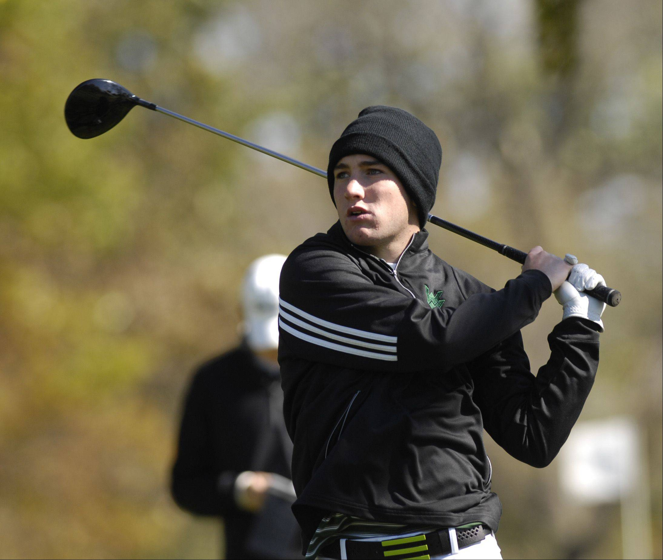 Austin Datz of Waubonsie Valley tees off during the St. Charles East boys varsity golf sectional at St. Andrews Golf Club in West Chicago, Monday.
