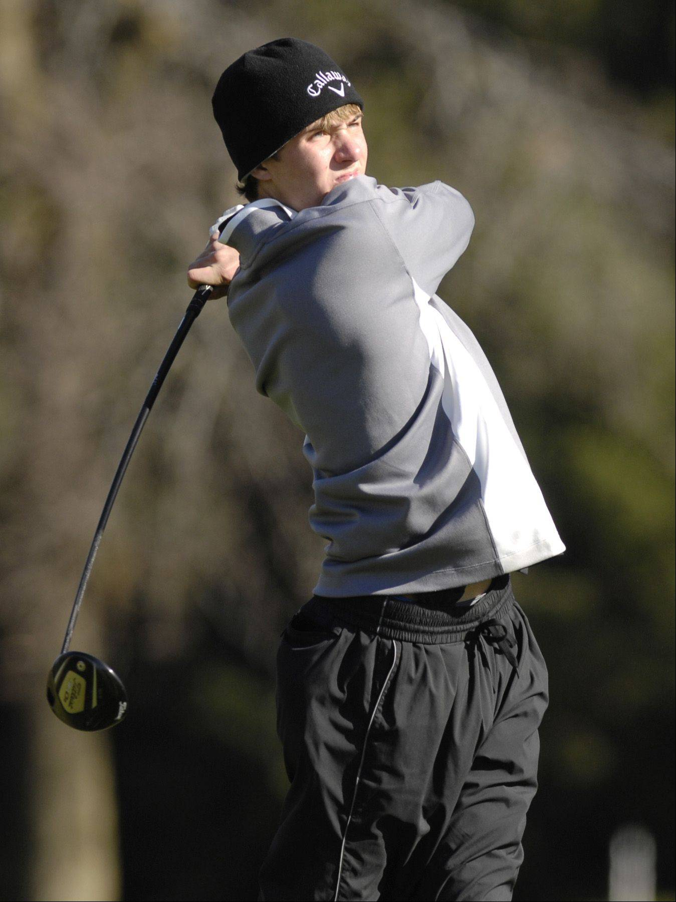 Adam Gracik of York tees off during the St. Charles East boys varsity golf sectional at St. Andrews Golf Club in West Chicago, Monday.