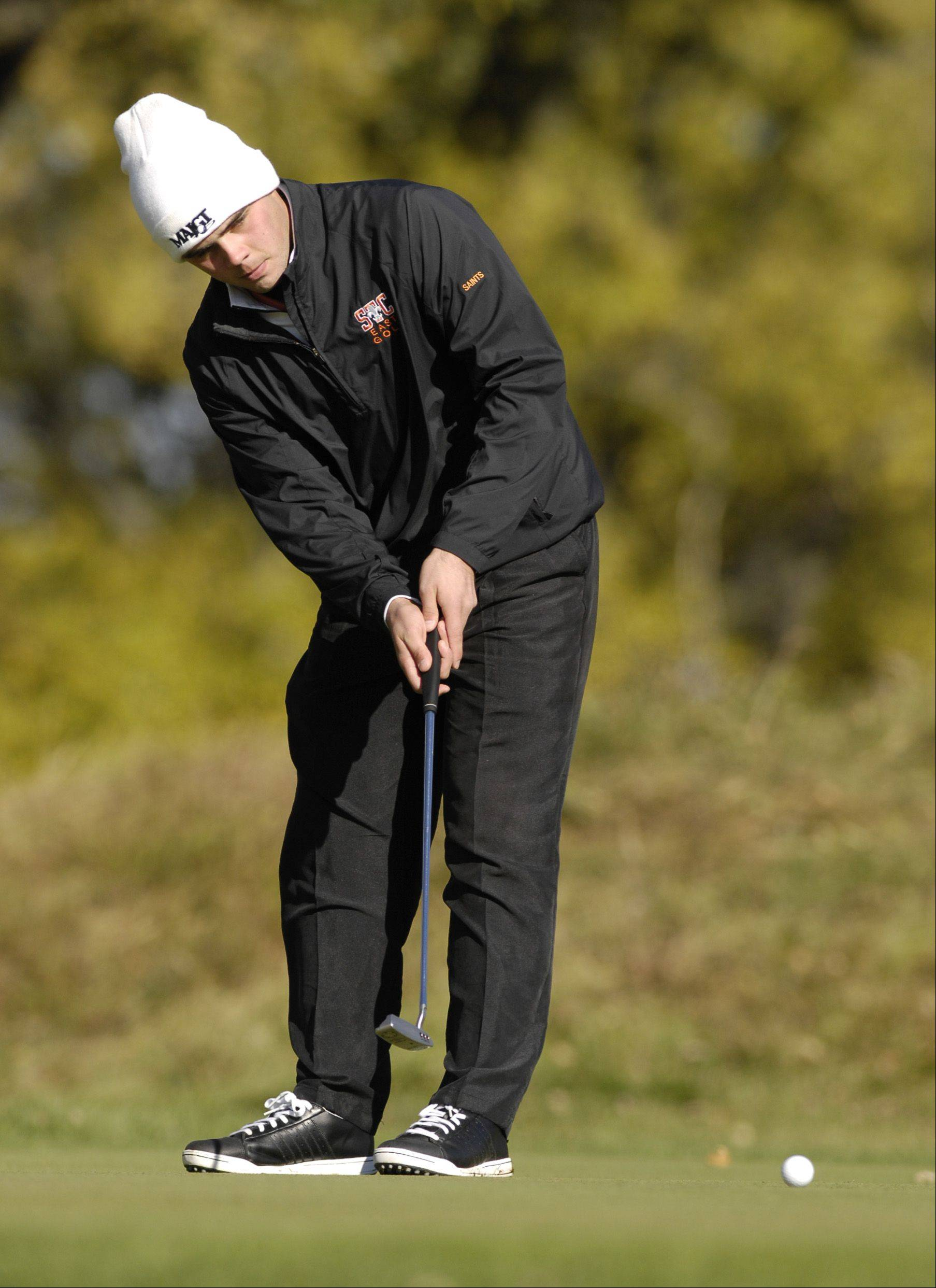 Max Kelly of St. Charles East putts off during the St. Charles East boys varsity golf sectional at St. Andrews Golf Club in West Chicago, Monday.