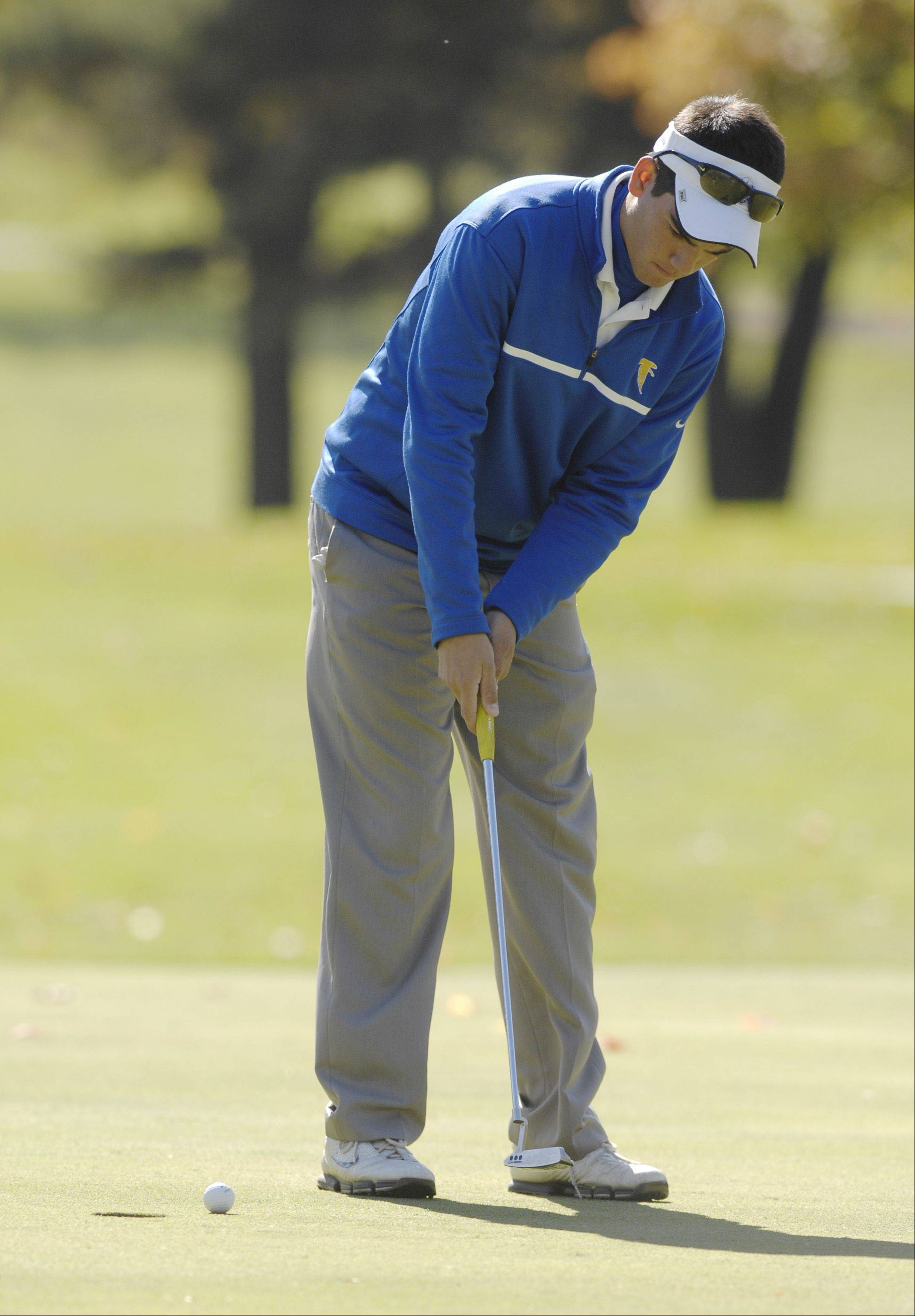 Michael Suazo of Wheaton North putts during the St. Charles East boys varsity golf sectional at St. Andrews Golf Club in West Chicago, Monday.