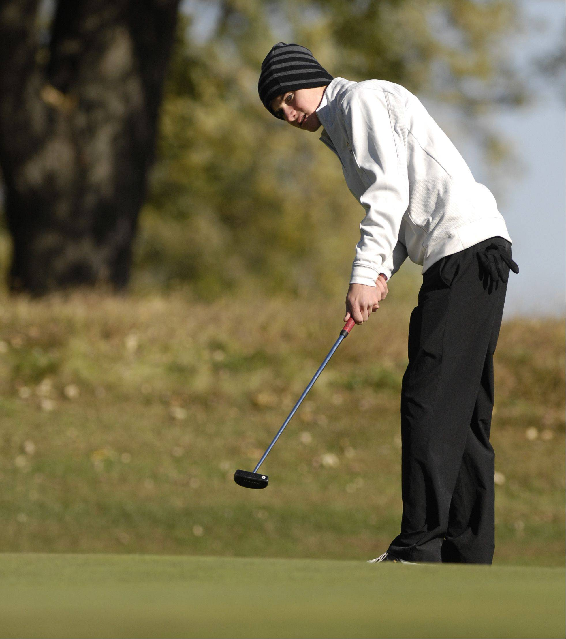 Jordan Less of York putts during the St. Charles East boys varsity golf sectional at St. Andrews Golf Club in West Chicago, Monday.